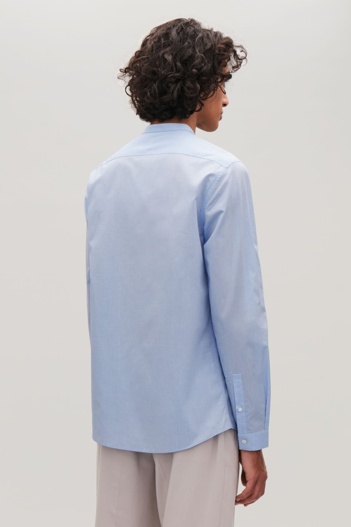 Model side image of Cos collarless cotton shirt in blue