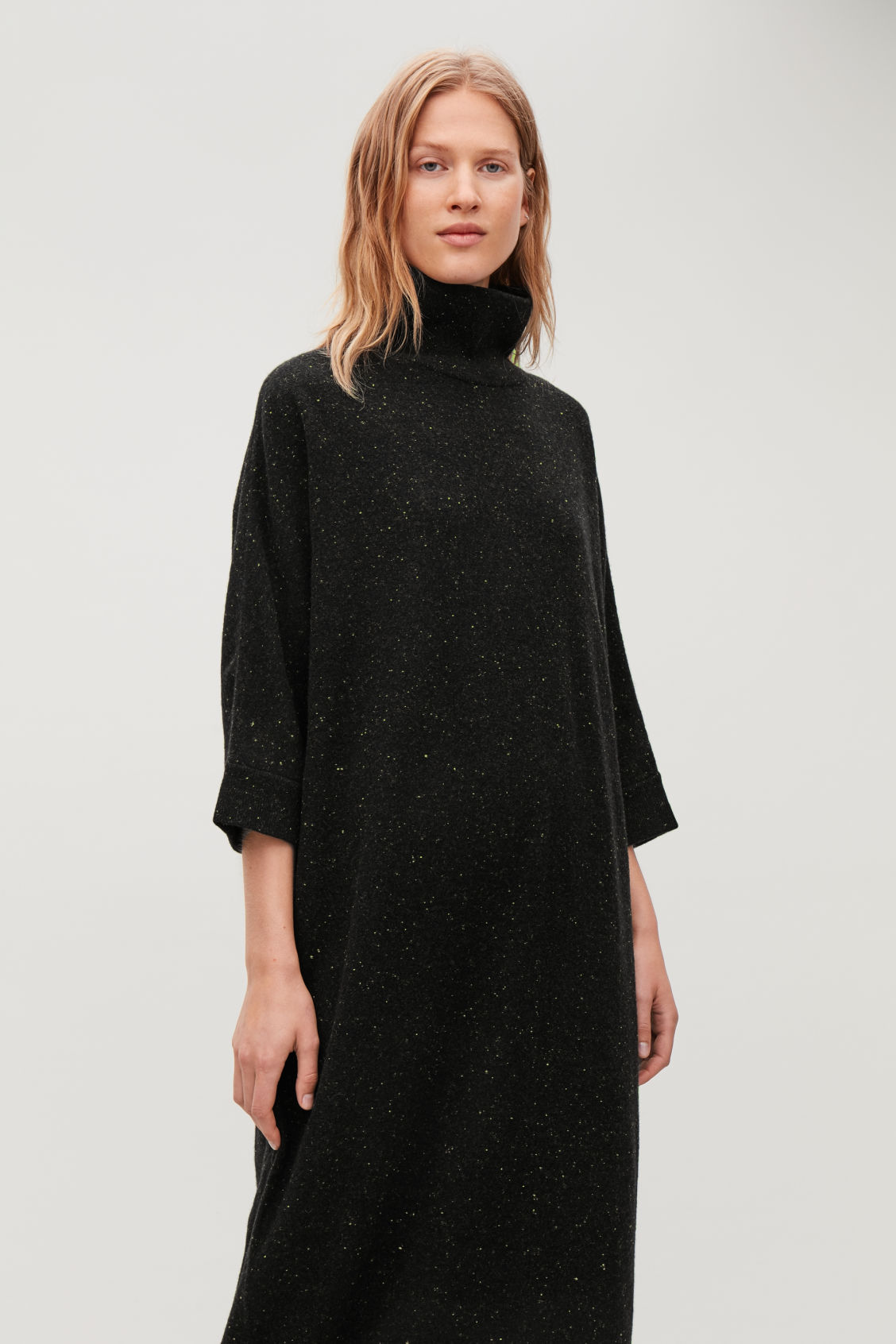 Model side image of Cos speckled high-neck dress in black