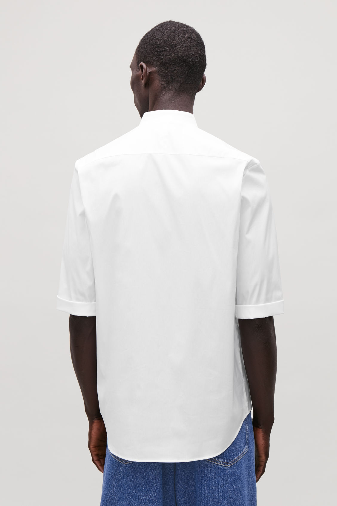 Model side image of Cos 3/4-sleeved grandad shirt in white