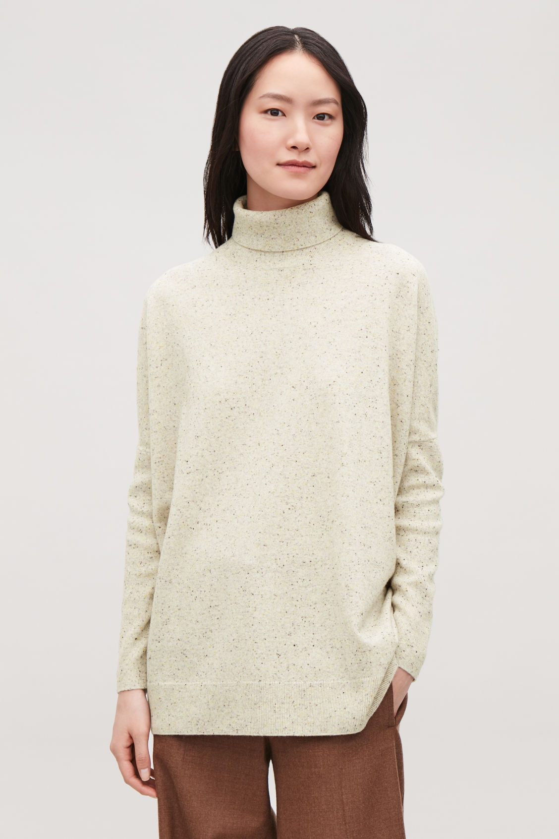 Model side image of Cos roll-neck merino jumper in silver