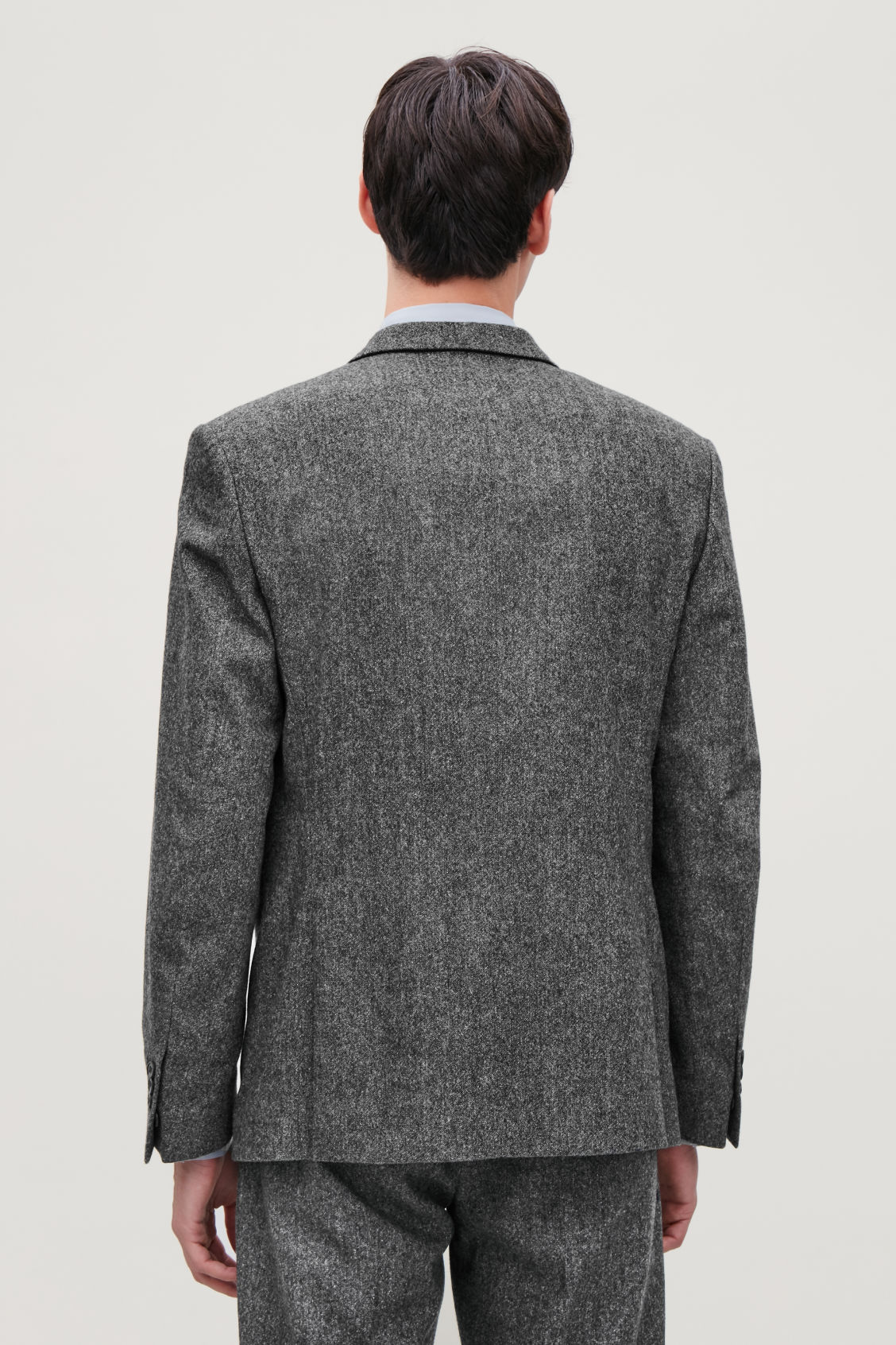 Model side image of Cos wool melange blazer in grey