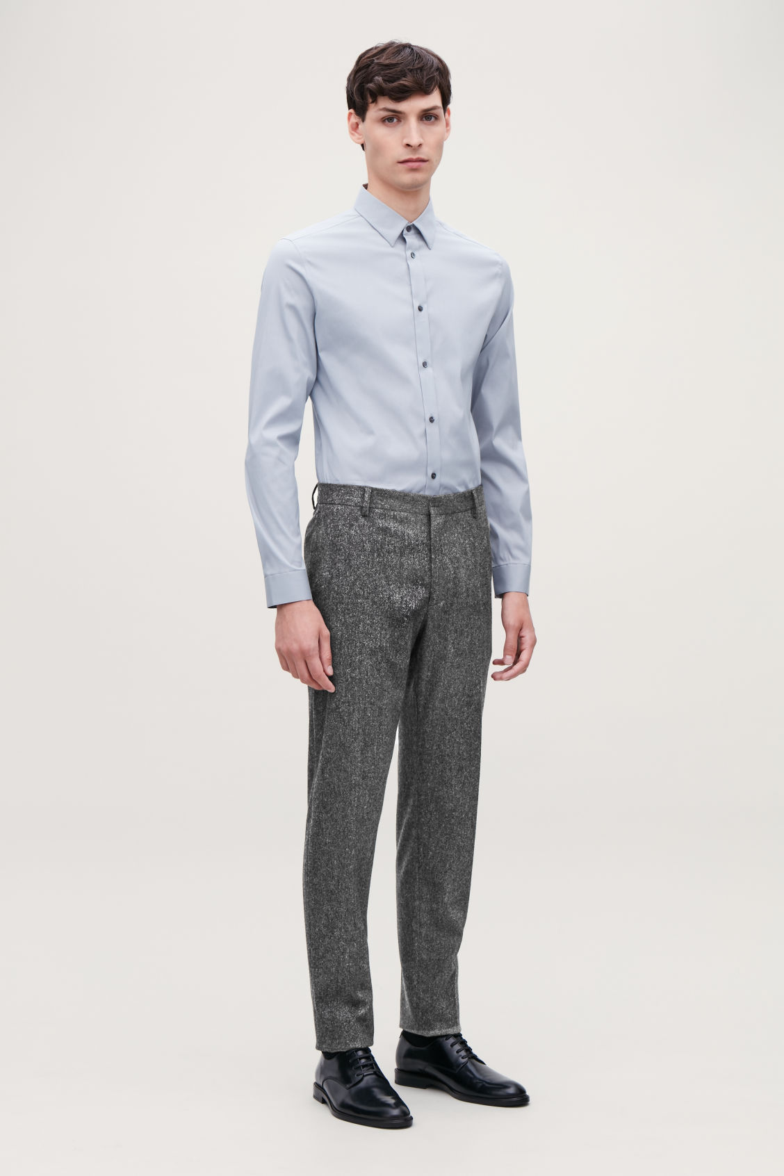 Model front image of Cos wool melange trousers in grey