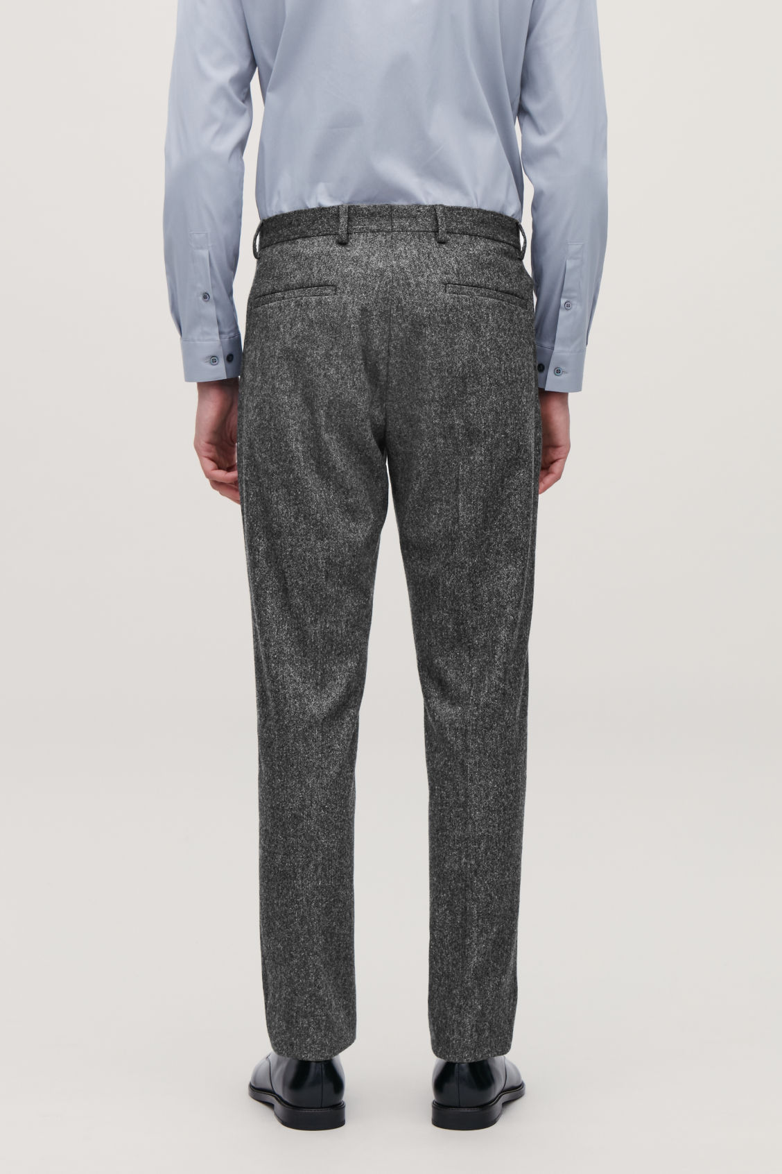 Model side image of Cos wool melange trousers in grey