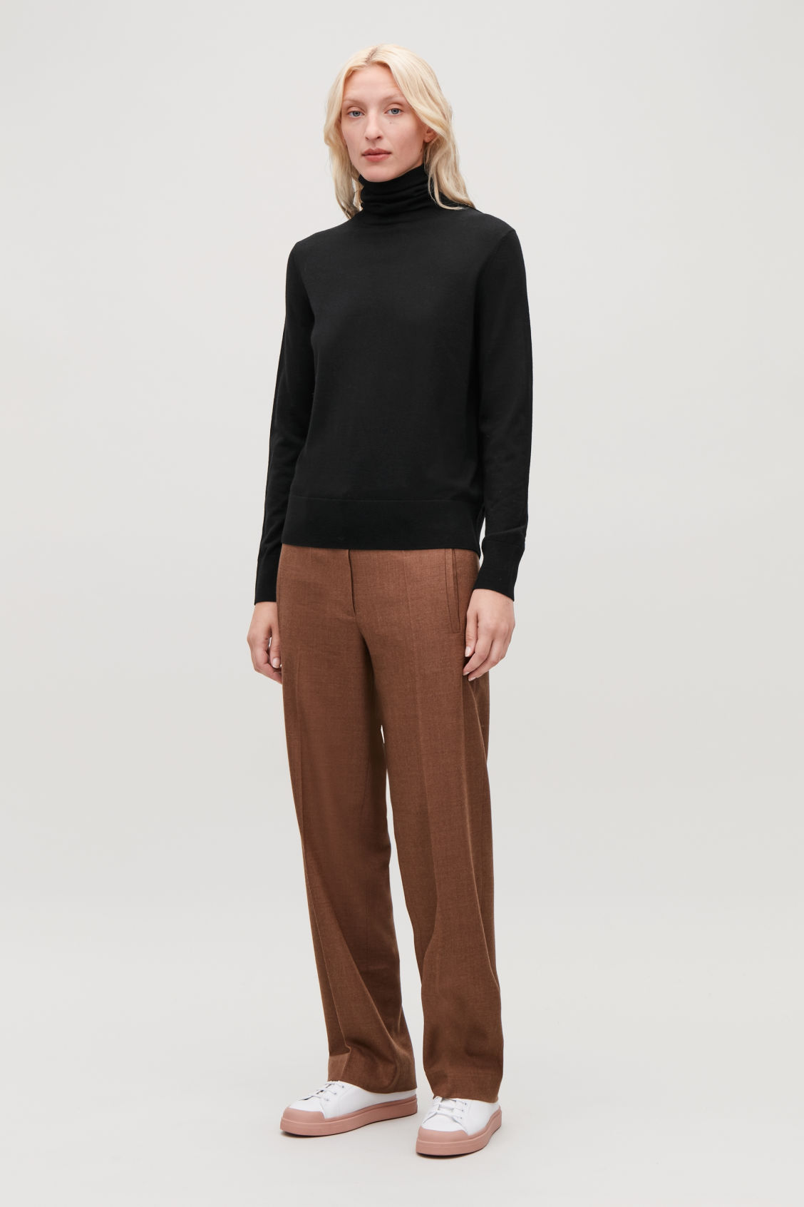 Model front image of Cos roll-neck merino jumper in black