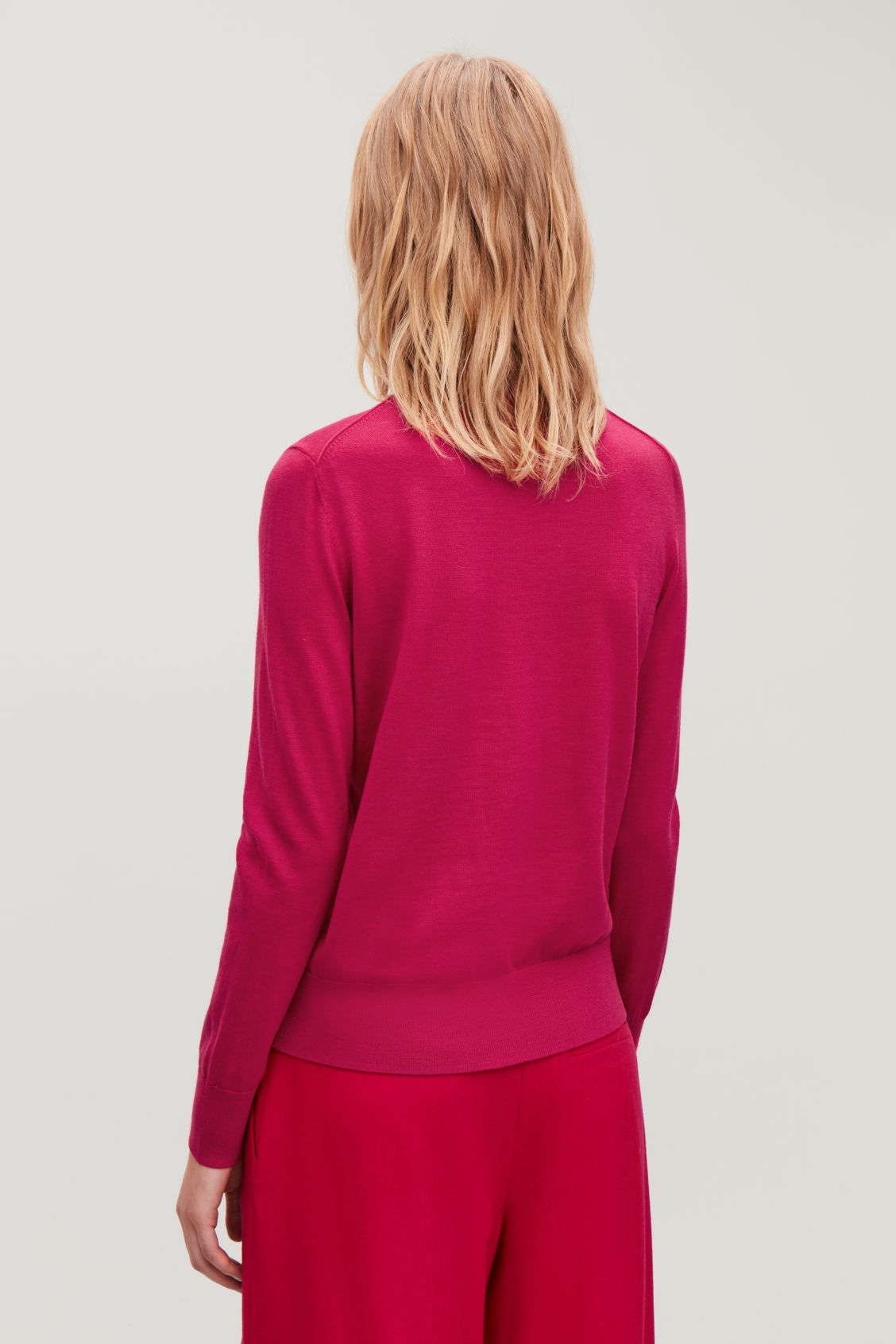 Model side image of Cos merino roll-neck jumper in pink