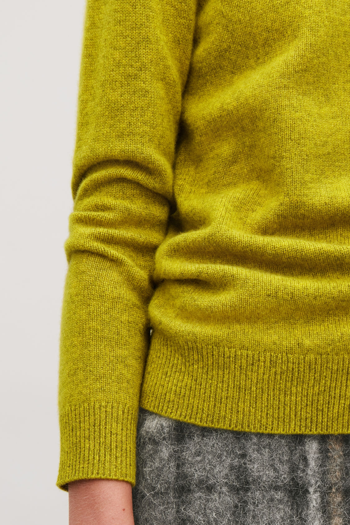 Model side image of Cos high-neck cashmere jumper in yellow