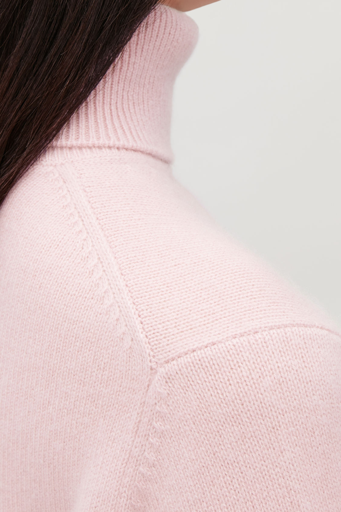 Model side image of Cos high-neck cashmere jumper in pink