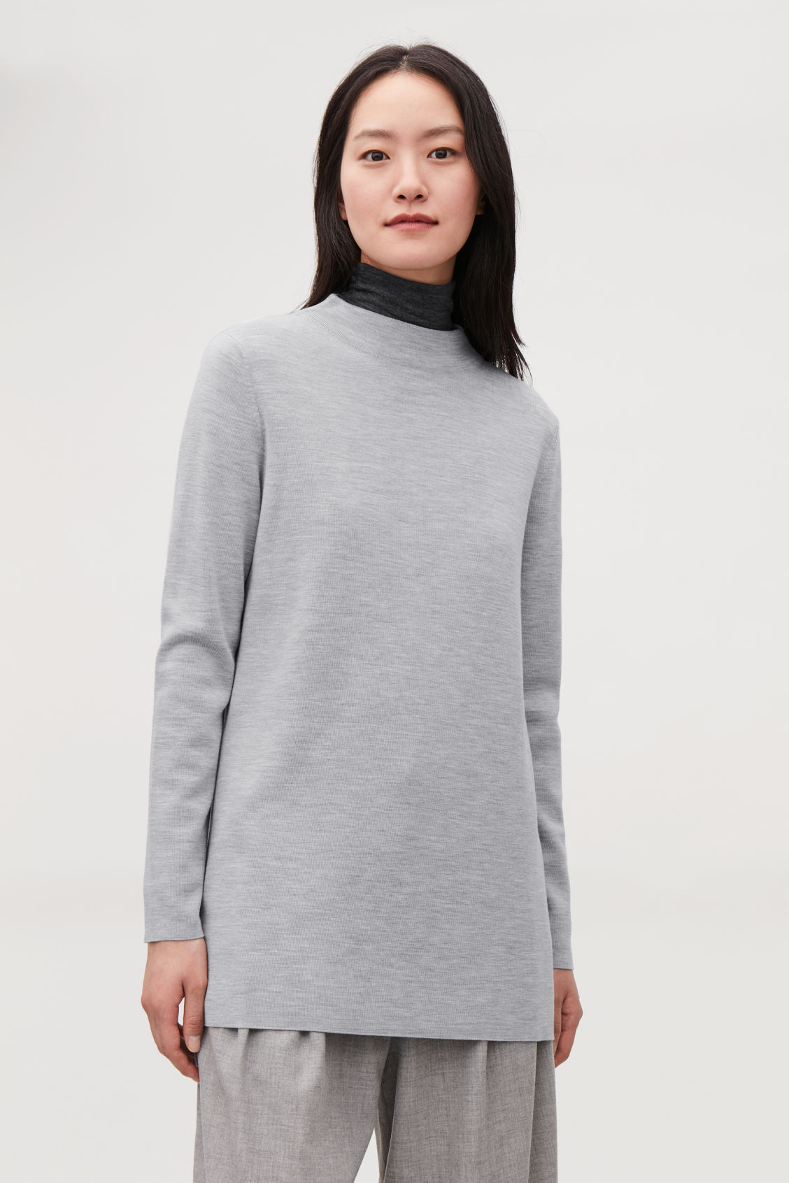 Model side image of Cos high-neck merino jumper in grey