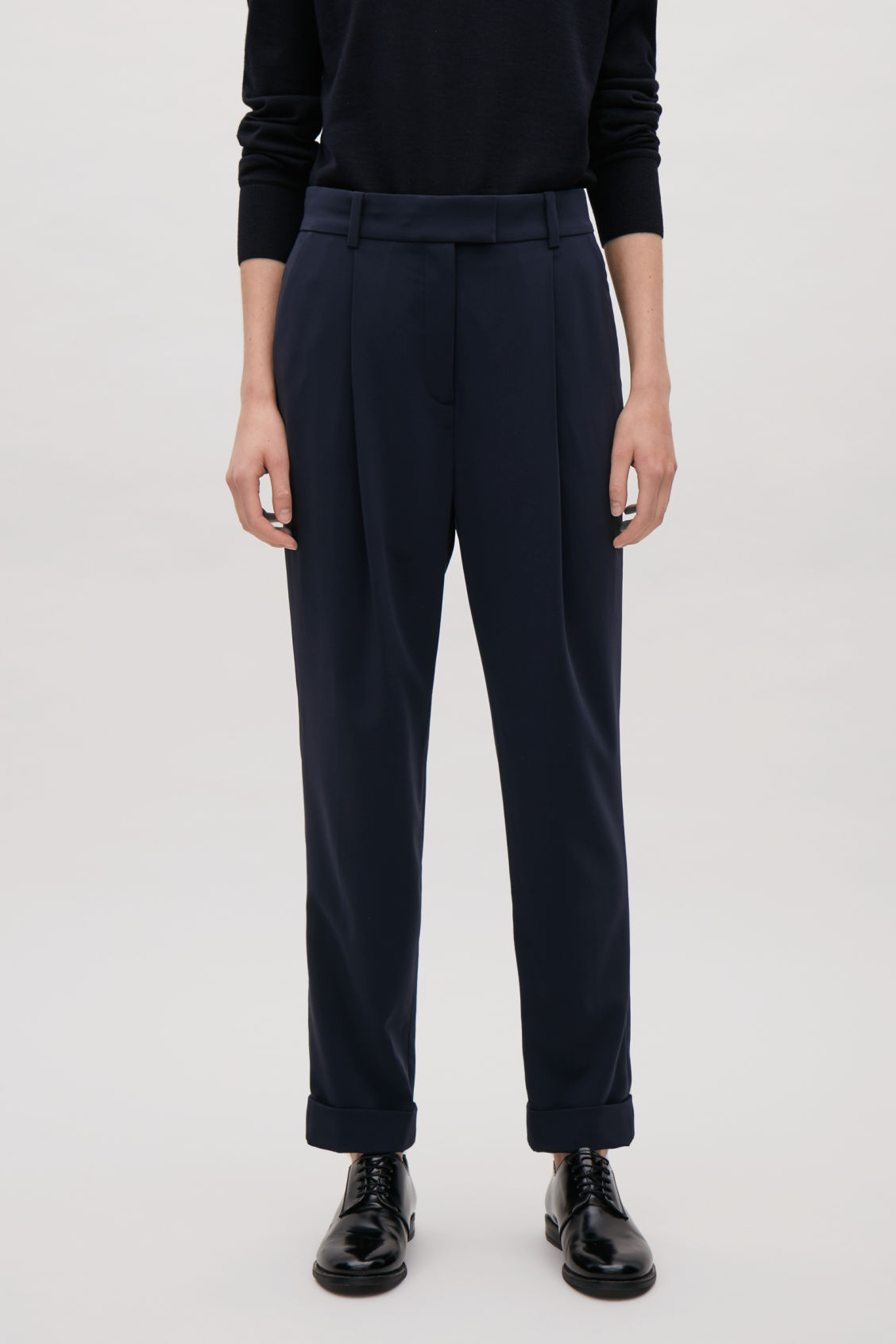 Model side image of Cos tailored pleat trousers in blue