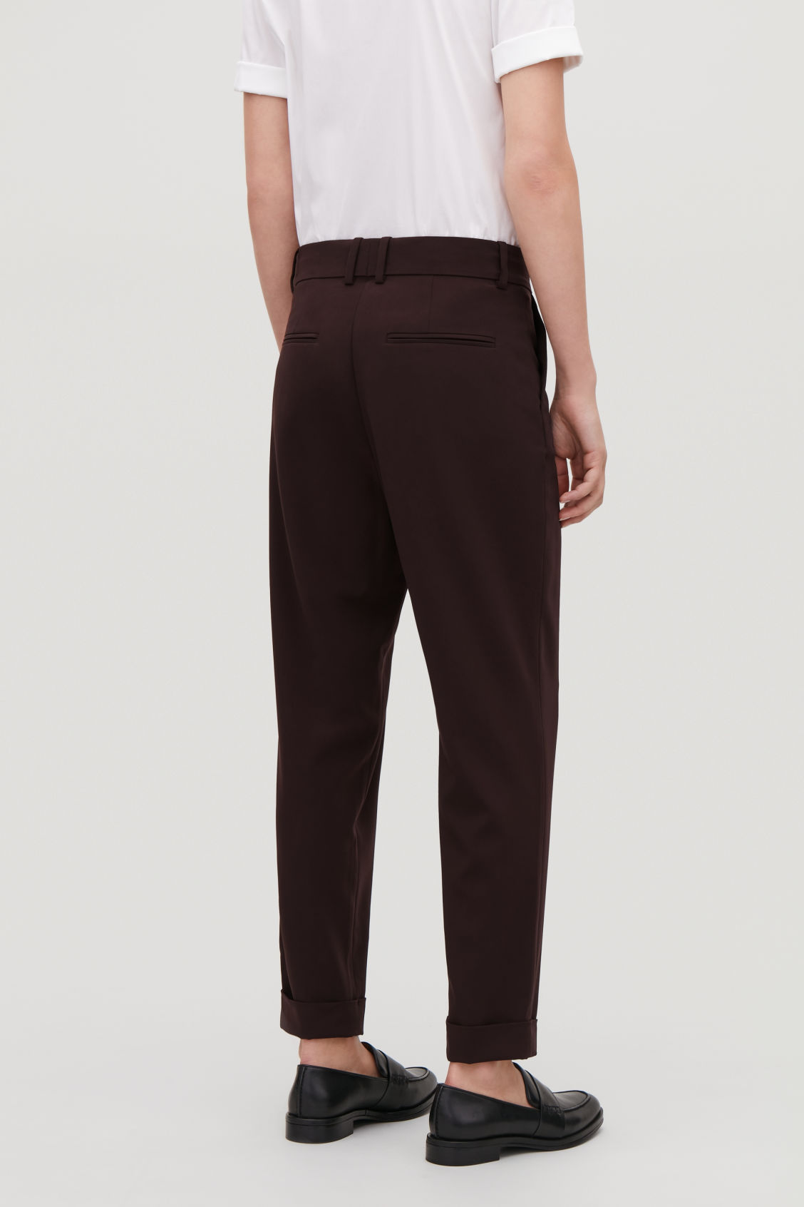 Model side image of Cos tailored pleat trousers in purple