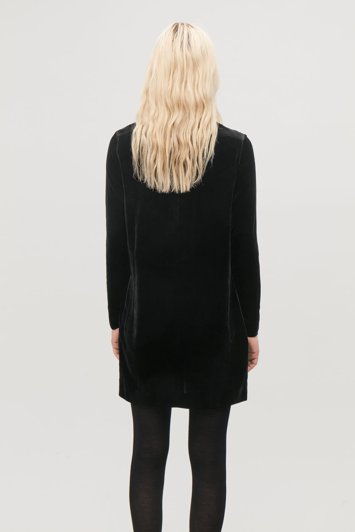 Model side image of Cos velvet dress in black