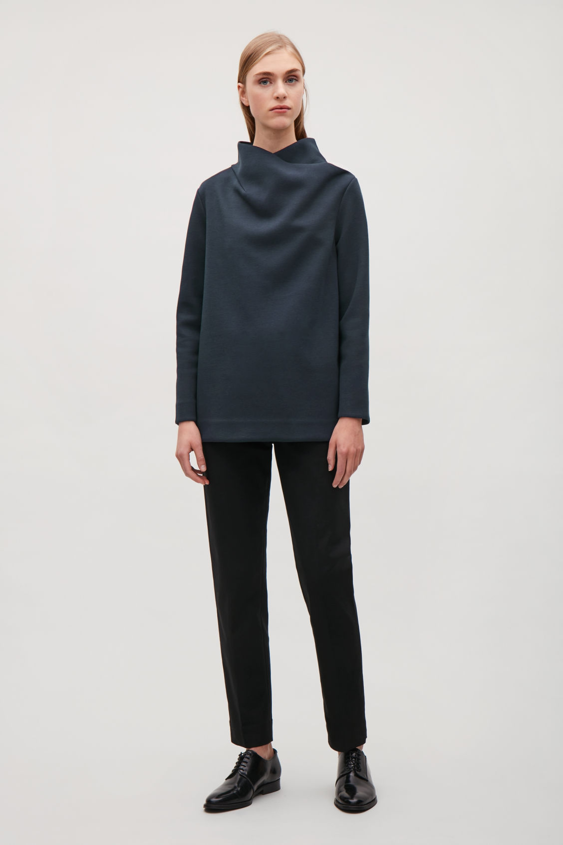 Model front image of Cos top with draped neck in blue
