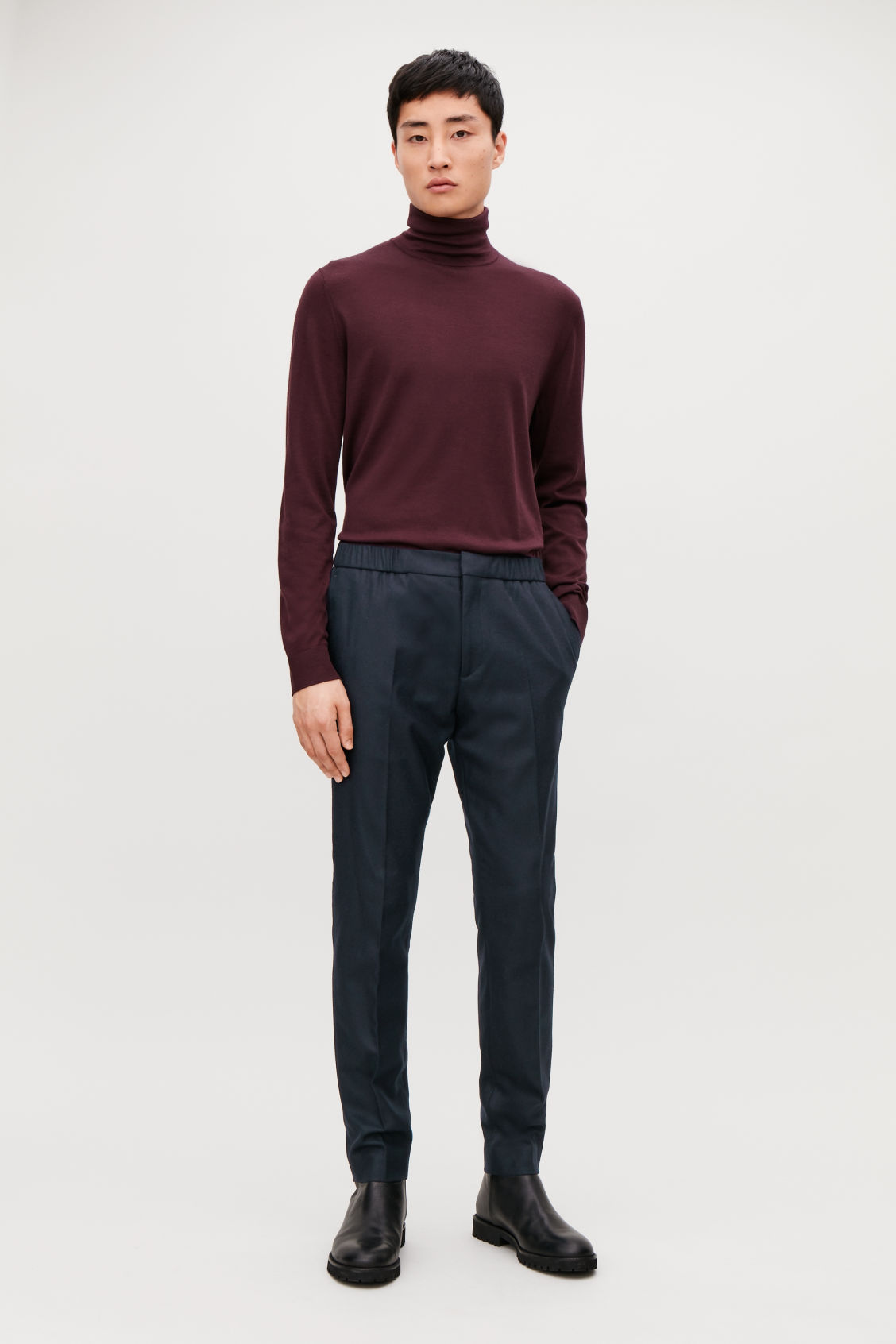 Model front image of Cos slim drawstring trousers in blue