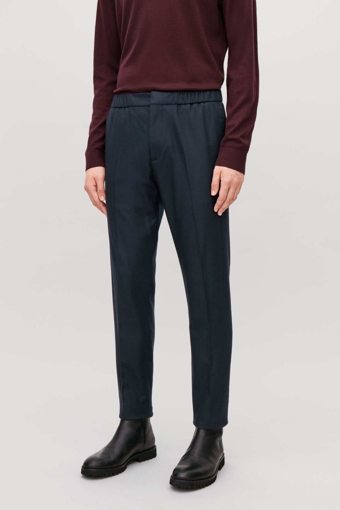 Model side image of Cos slim drawstring trousers in blue