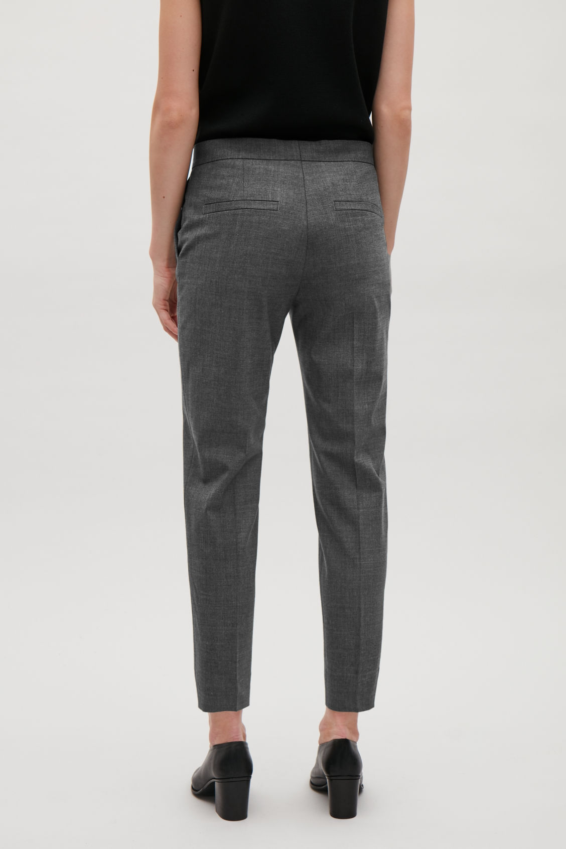 Model side image of Cos tailored slim-fit trousers in grey