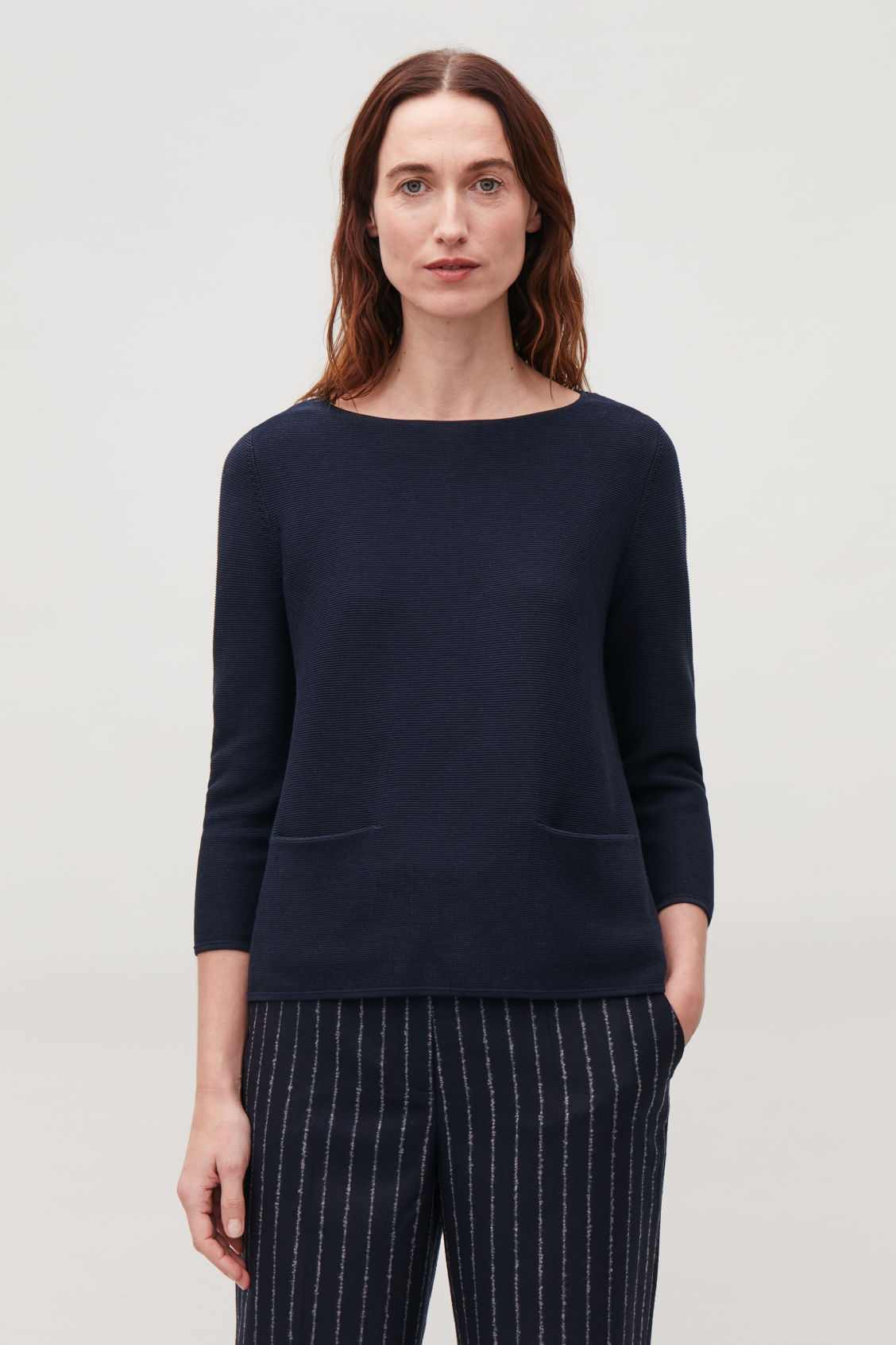 Model side image of Cos a-line cotton knitted top in blue