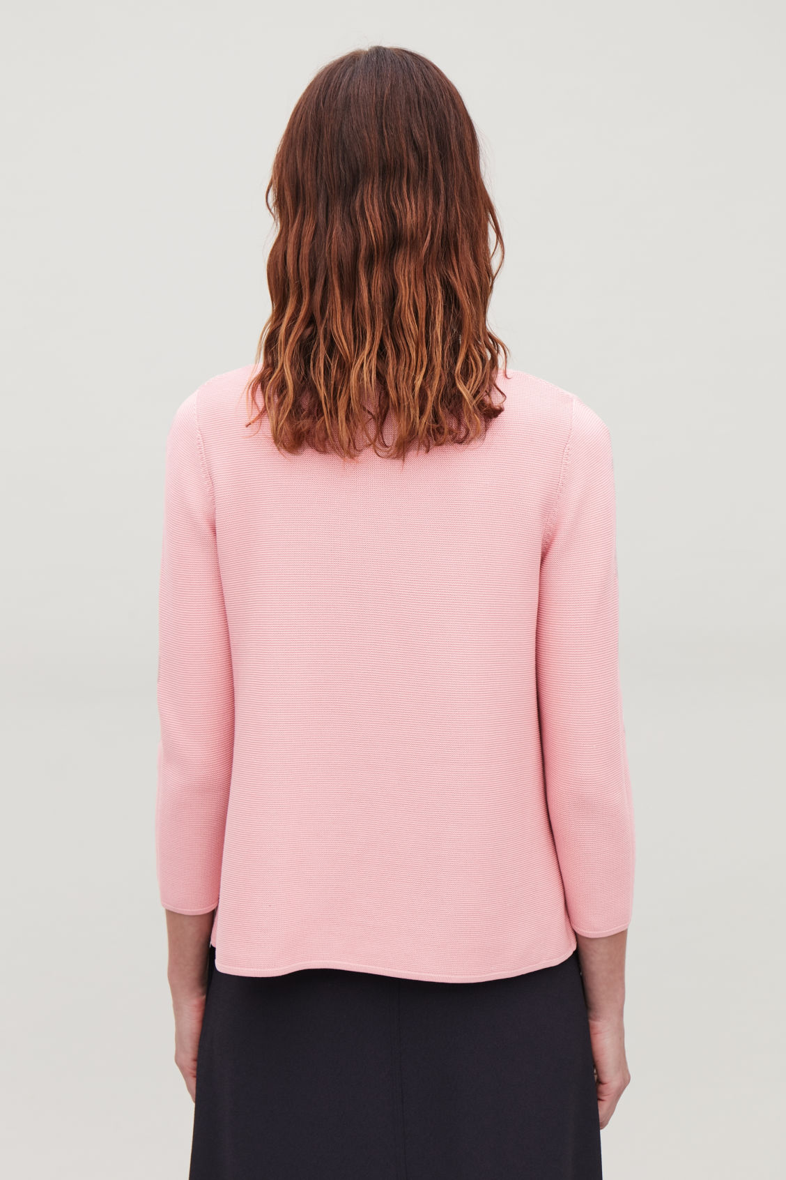 Model side image of Cos a-line cotton knitted top in pink