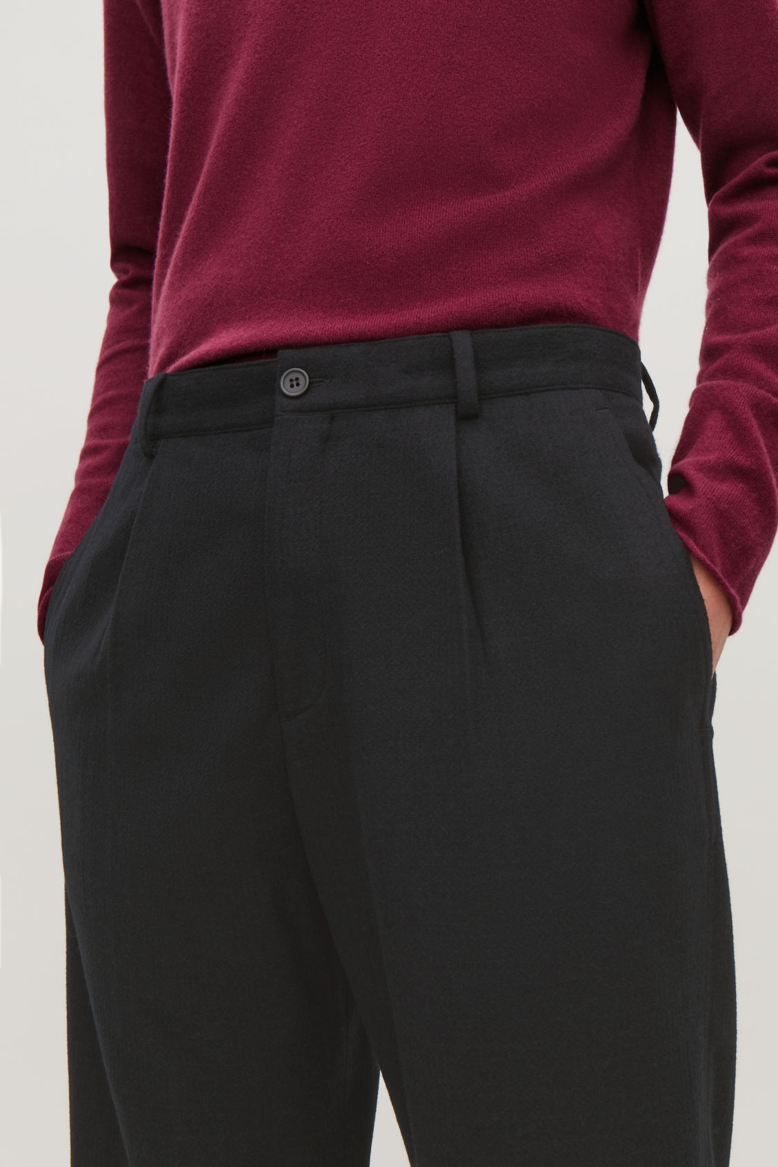 Model side image of Cos relaxed crepe wool trousers in black