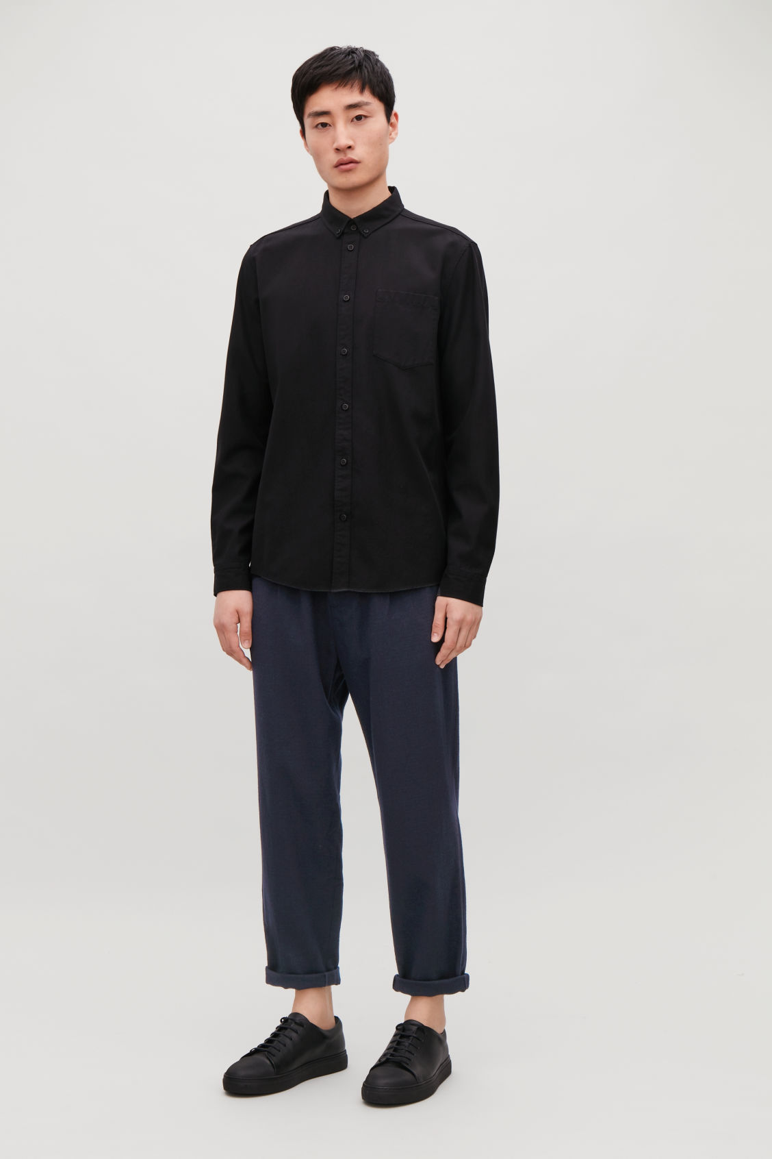 Model front image of Cos relaxed crepe wool trousers in blue