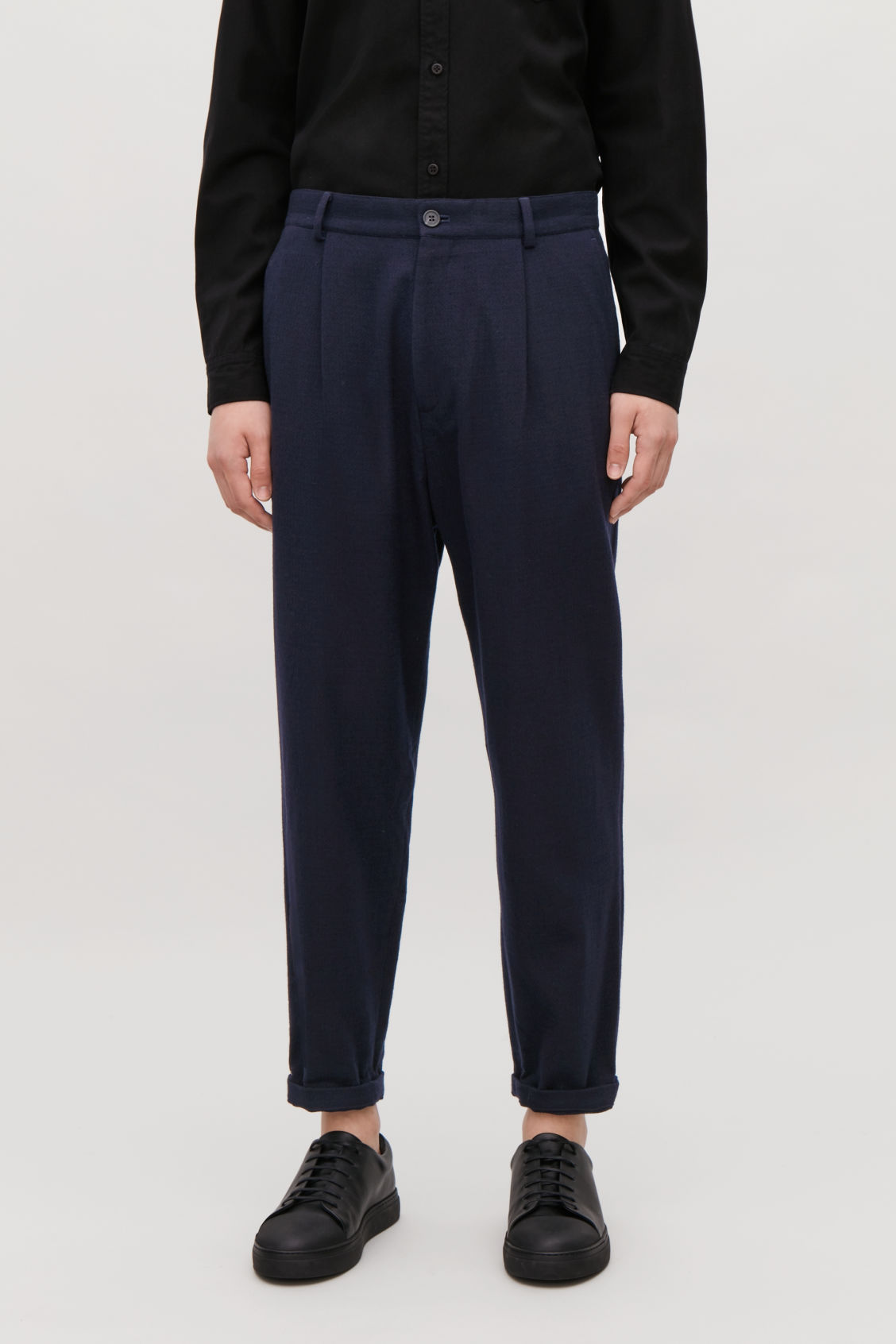 Model side image of Cos relaxed crepe wool trousers in blue