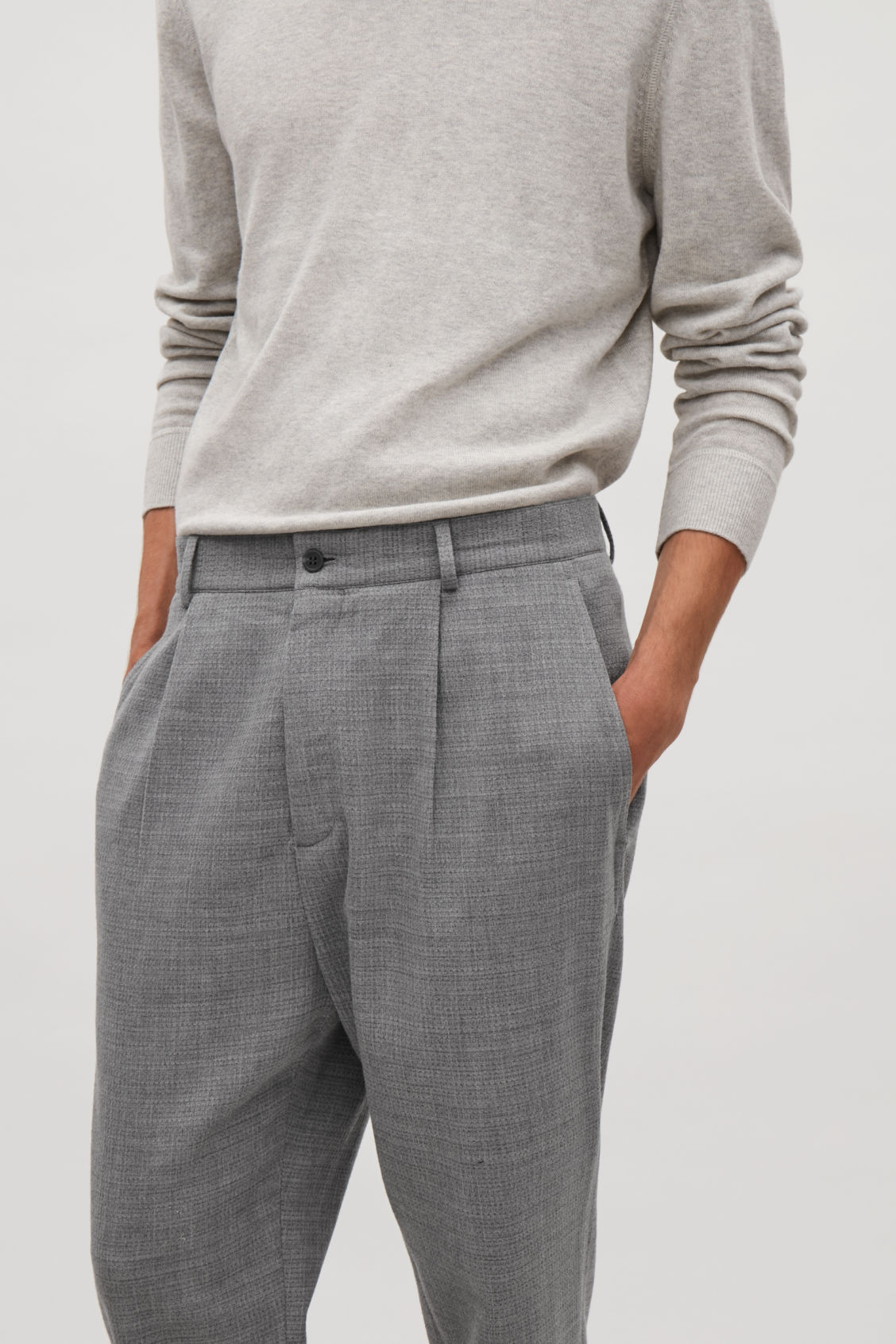 Model side image of Cos relaxed crepe wool trousers in grey