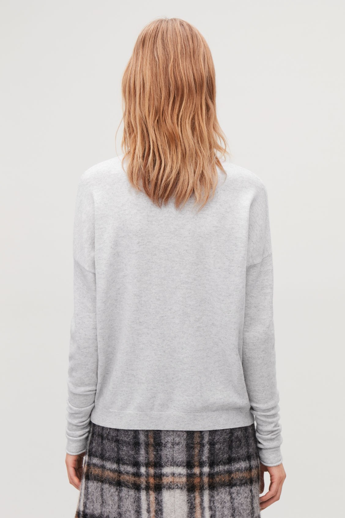 Model side image of Cos roll-neck cashmere jumper in grey