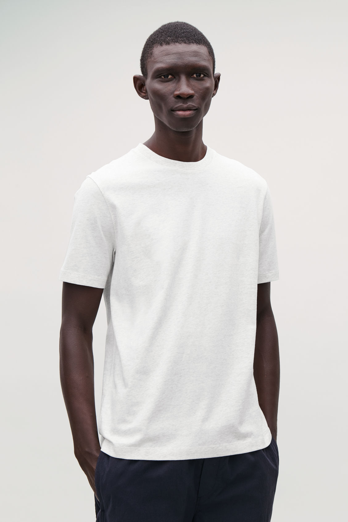 Model side image of Cos t-shirt with rib neck in grey