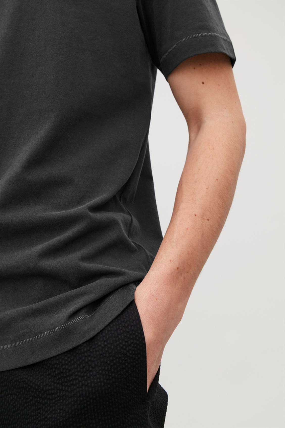 Model side image of Cos t-shirt with rib neck in black