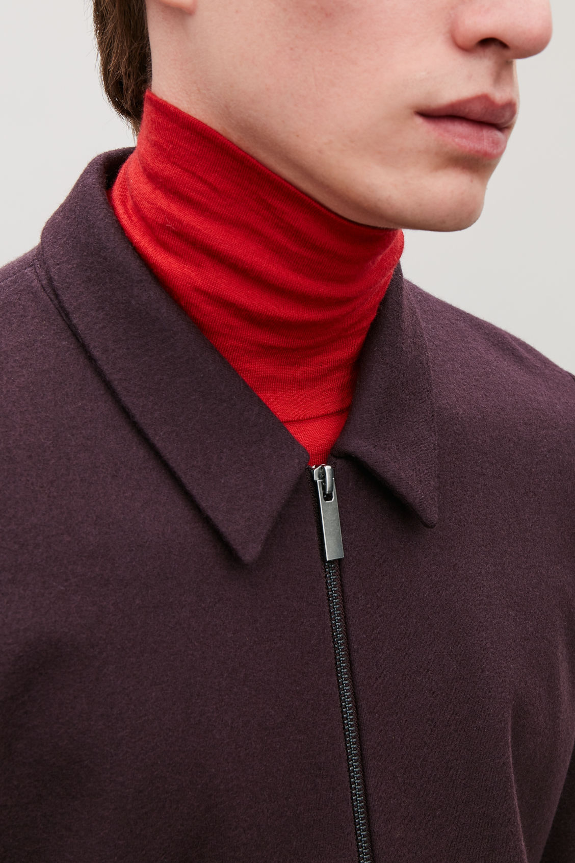 Model side image of Cos zip-up wool jacket in burgundy