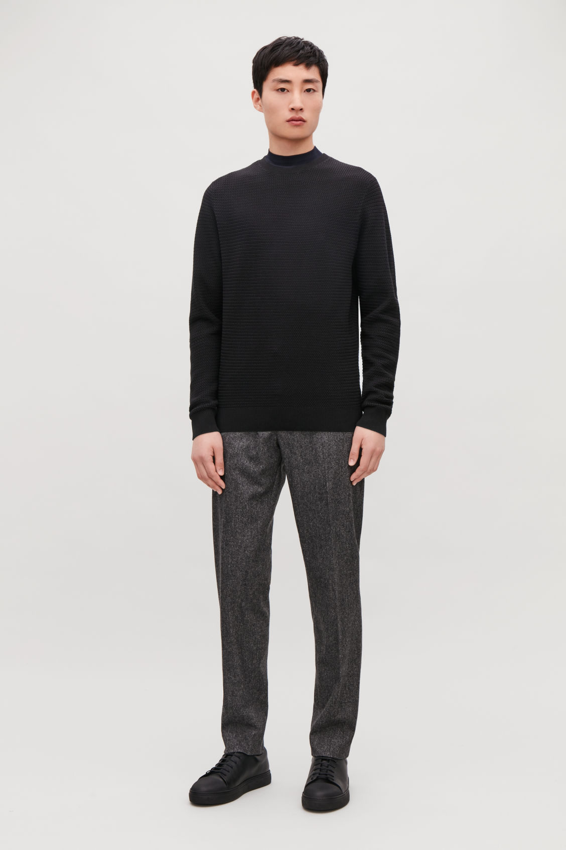 Model front image of Cos structured knit jumper in black