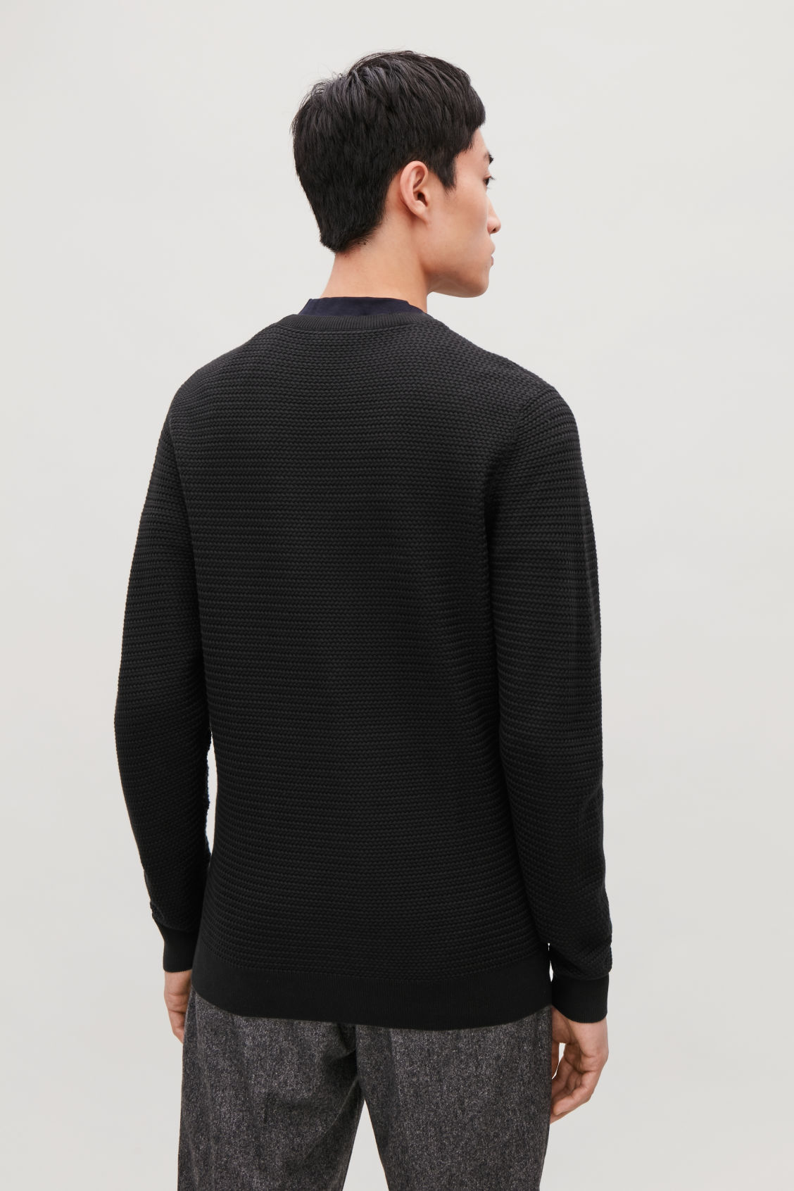 Model side image of Cos structured knit jumper in black
