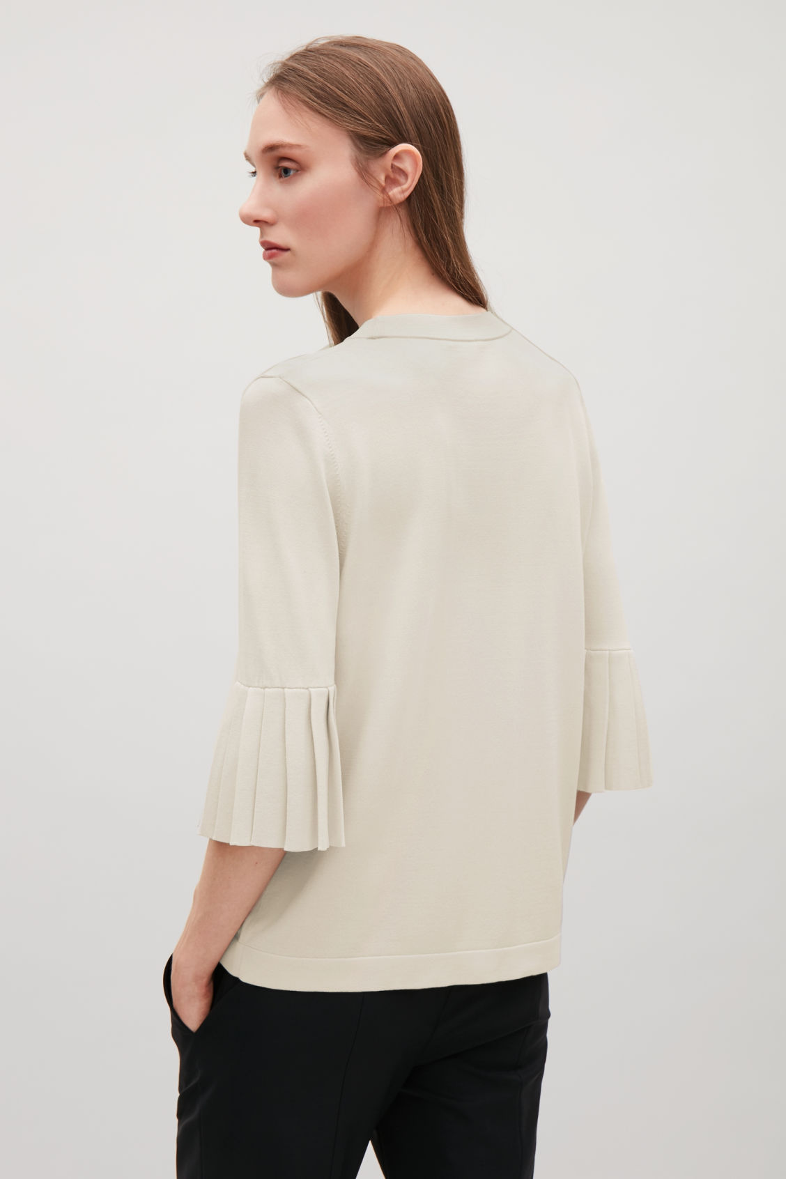 Model side image of Cos knitted top with pleated sleeves in beige