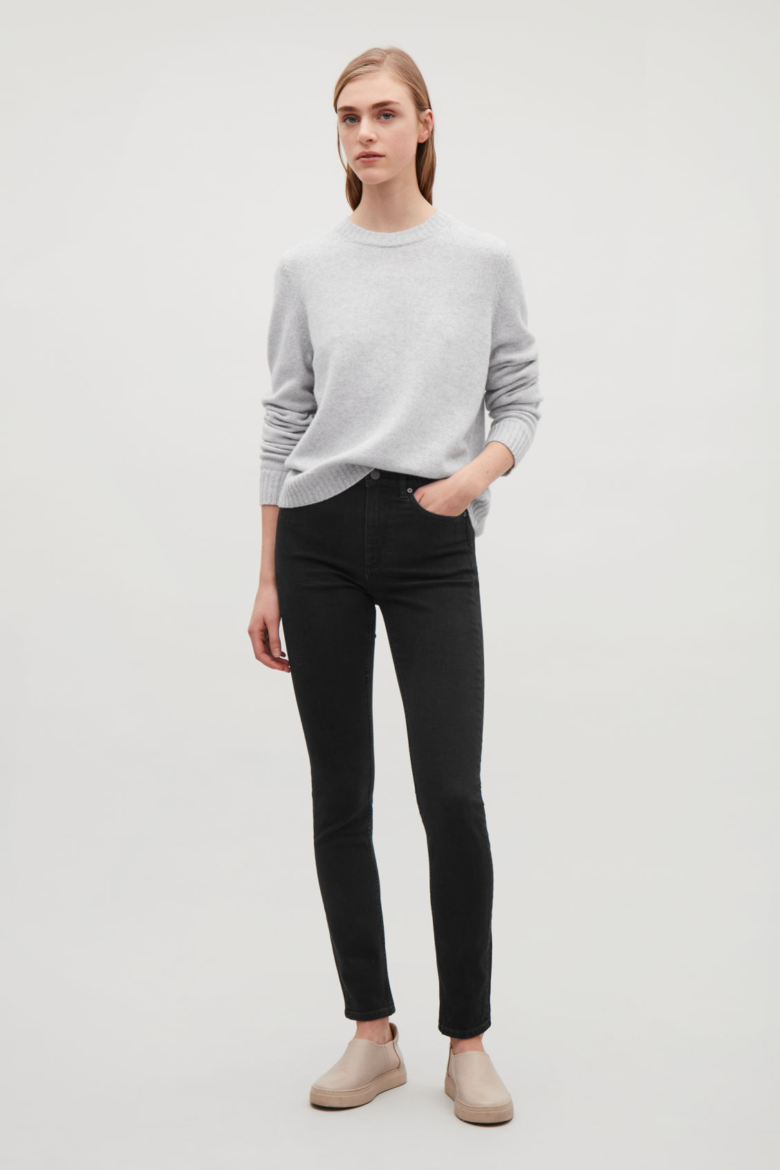Model side image of Cos skinny-fit cropped jeans in black