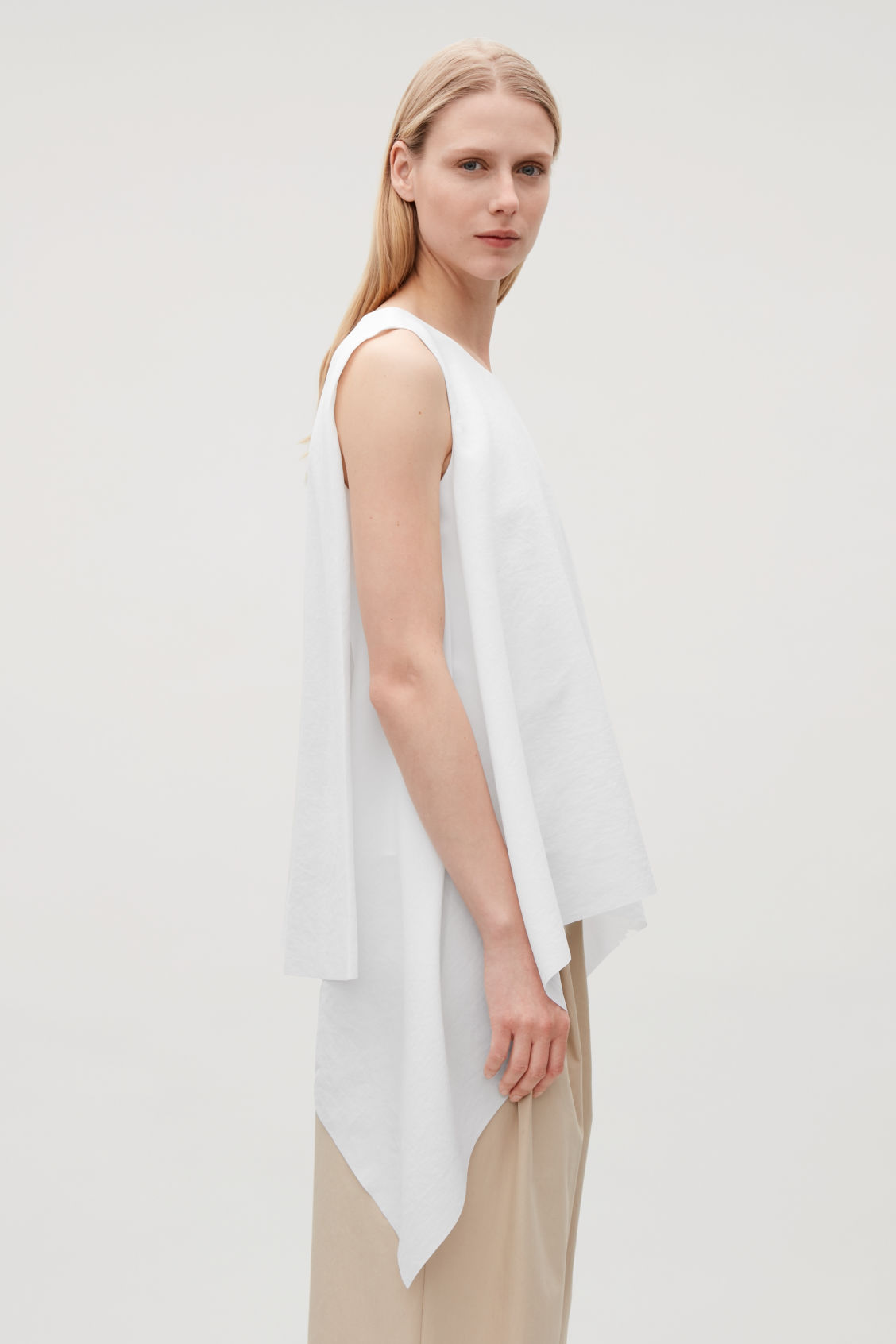 Model side image of Cos layered drape top in white