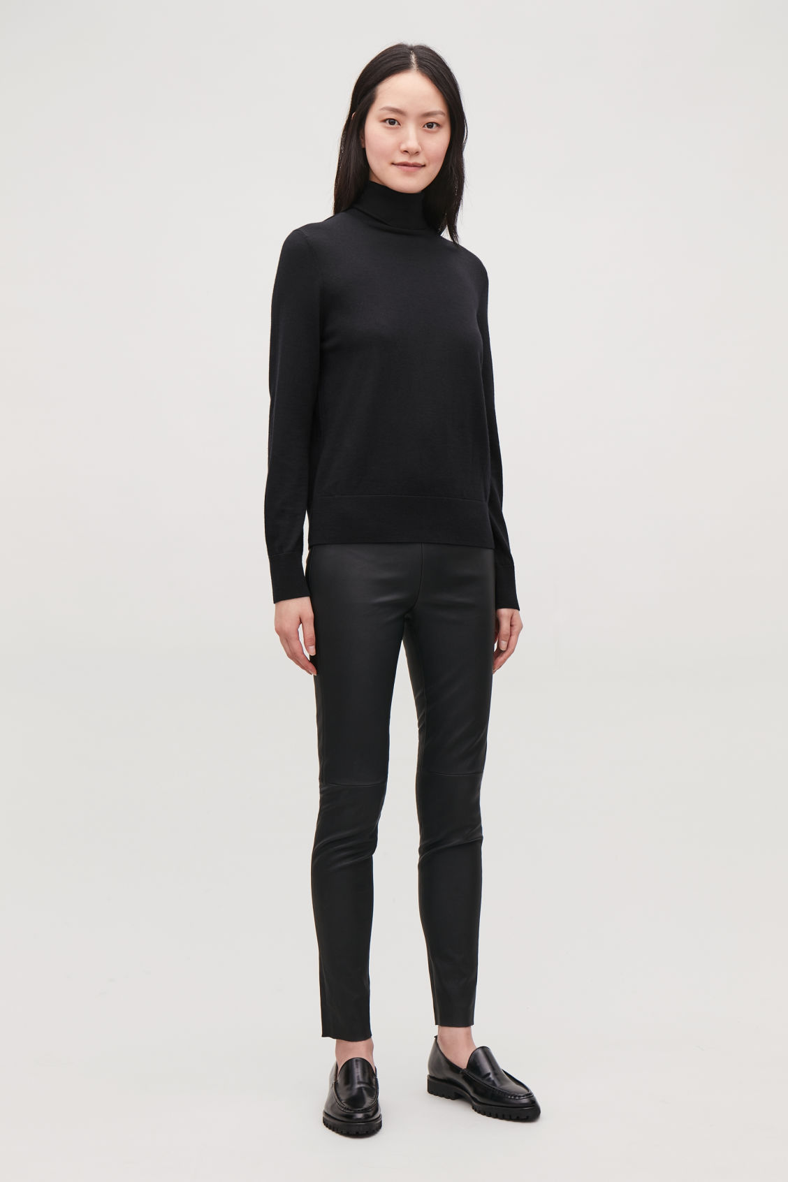 Model front image of Cos slim-fit leather trousers in black
