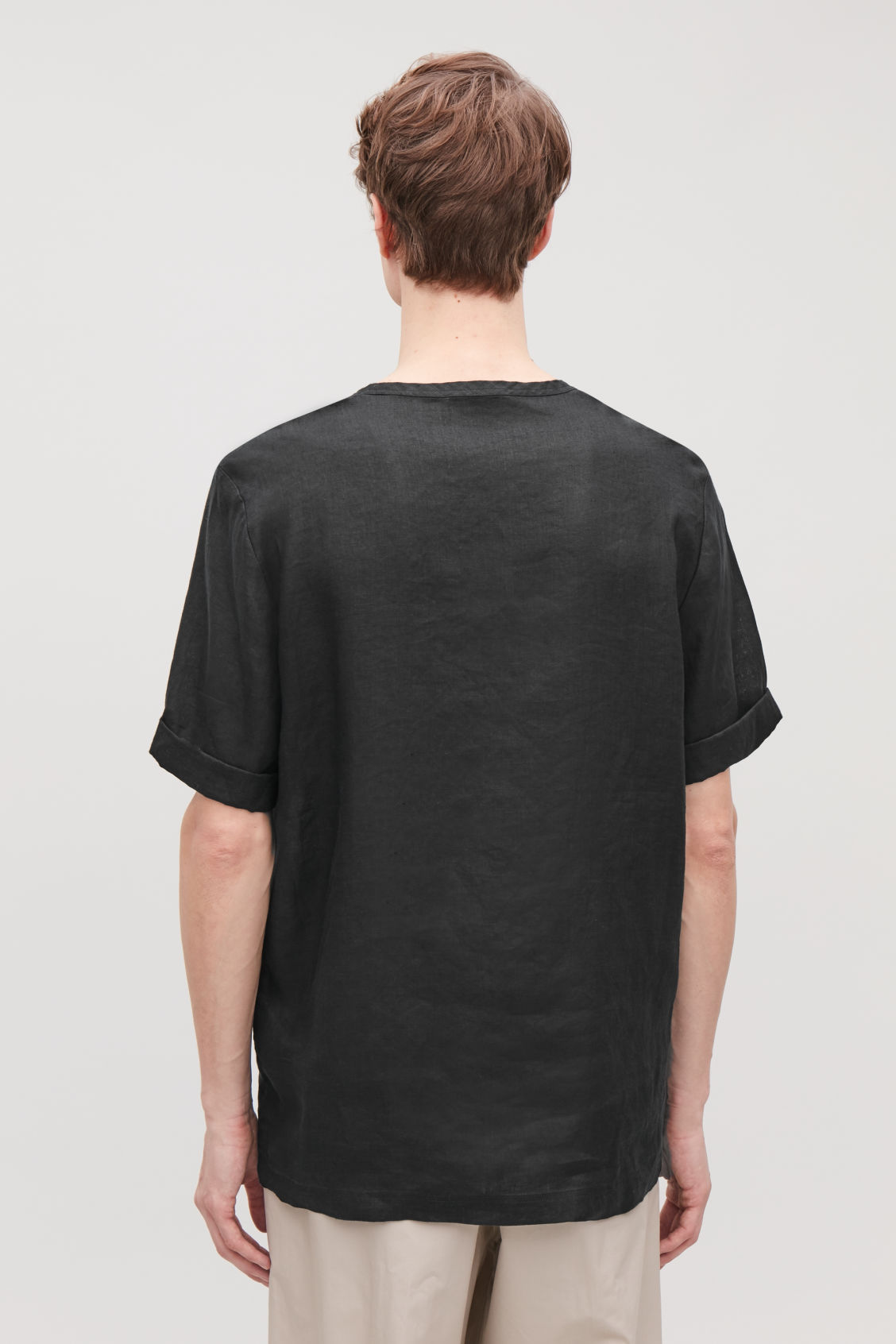 Model side image of Cos oversized linen t-shirt in black