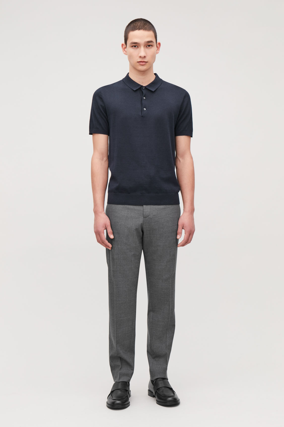 Model front image of Cos elasticated slim-fit trousers in grey