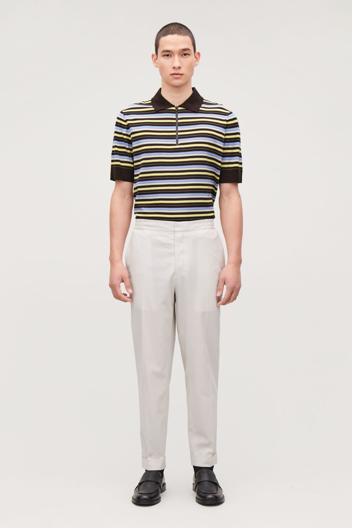 Model front image of Cos relaxed turn-up trousers in beige