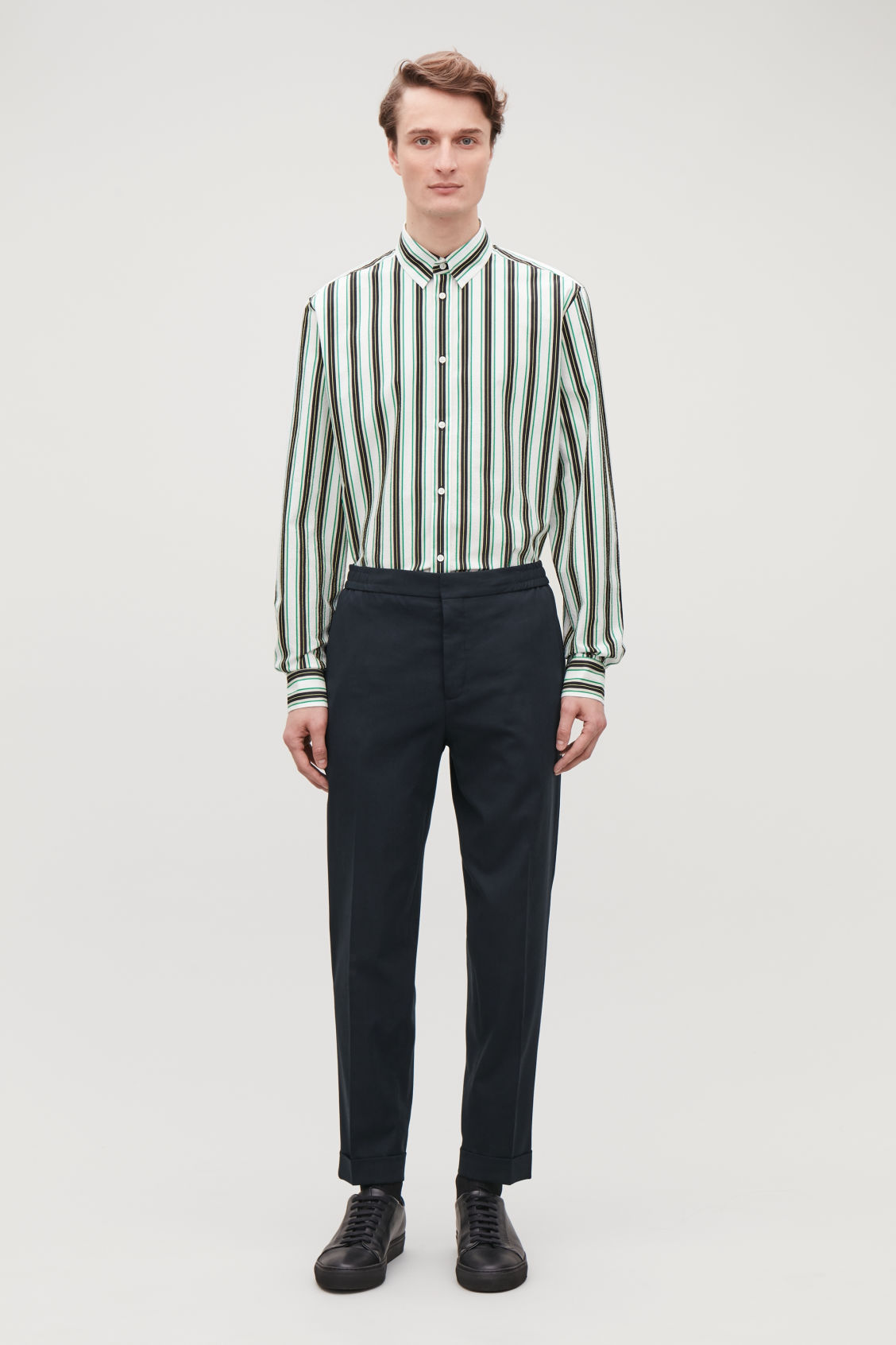 Model front image of Cos relaxed turn-up trousers in blue
