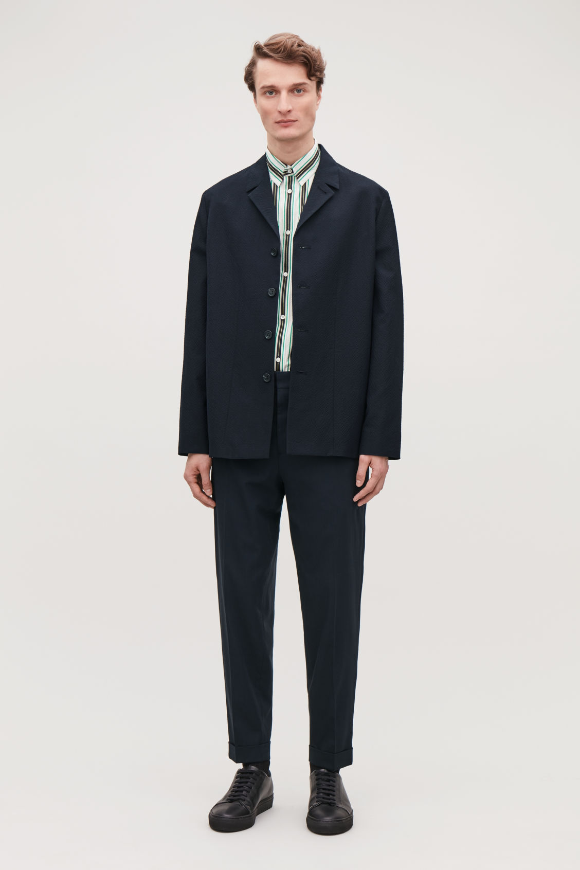 Model side image of Cos relaxed turn-up trousers in blue