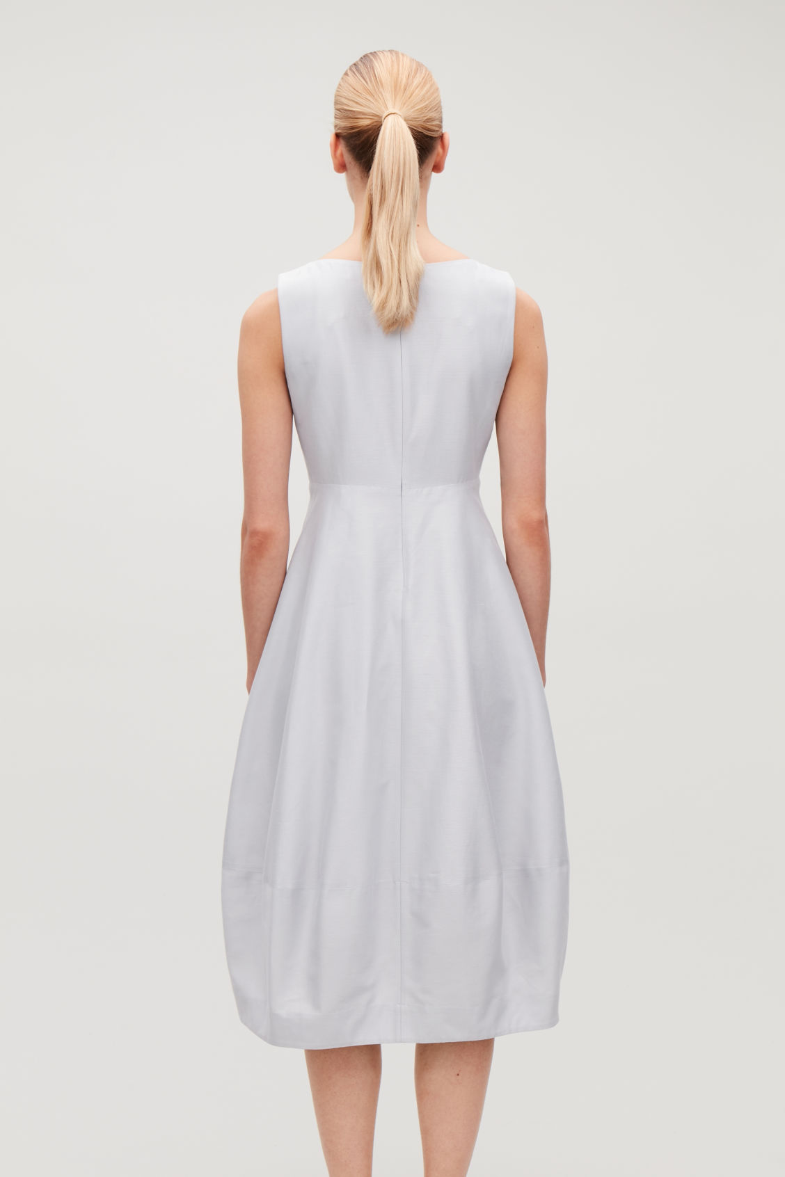 Model side image of Cos cotton-silk cocoon dress in grey