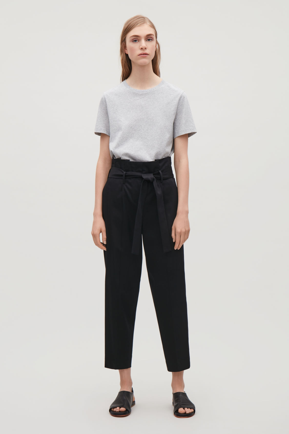 Model front image of Cos trousers with waist tie in black