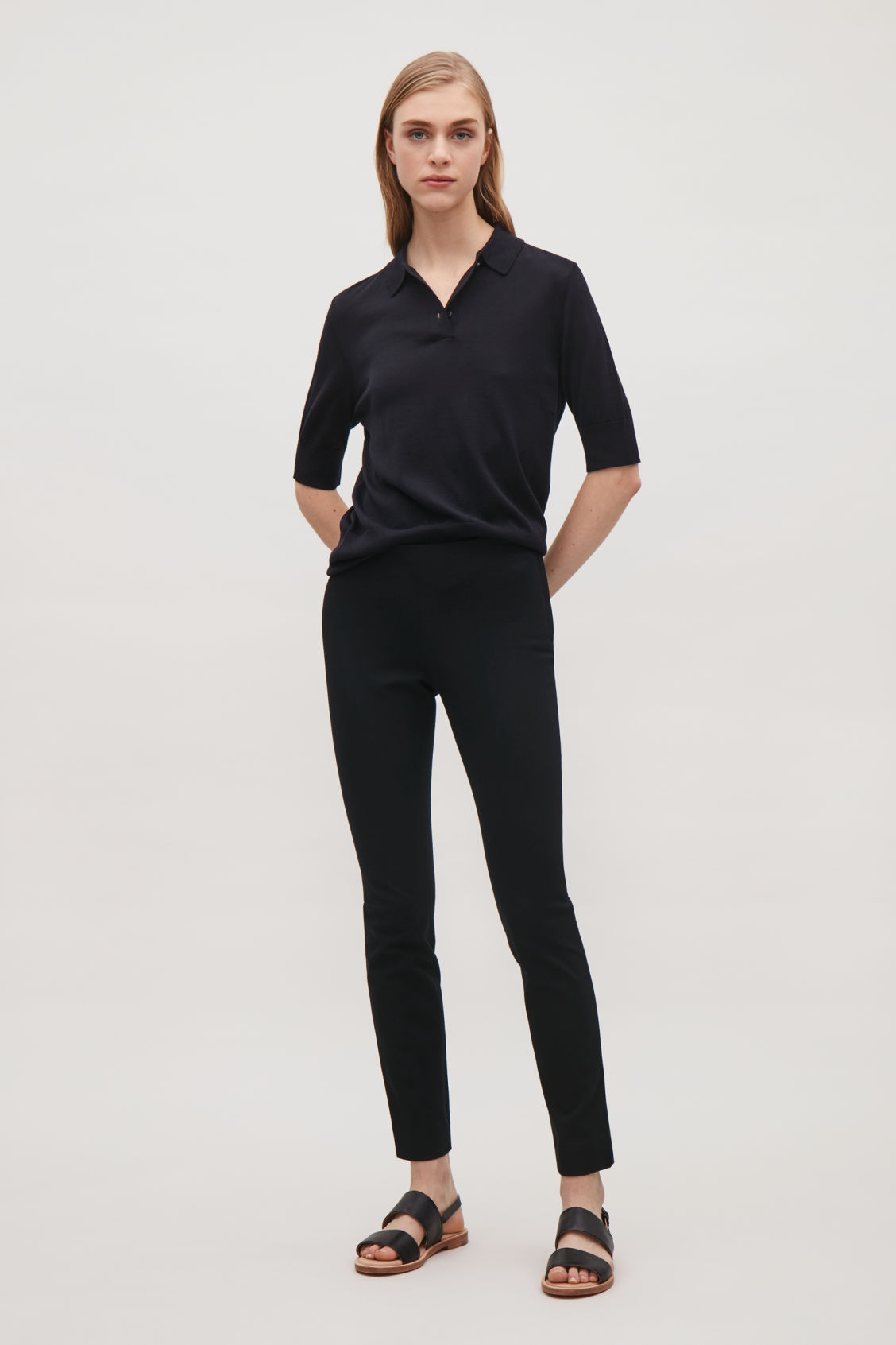 Model front image of Cos slim-fit trousers in black