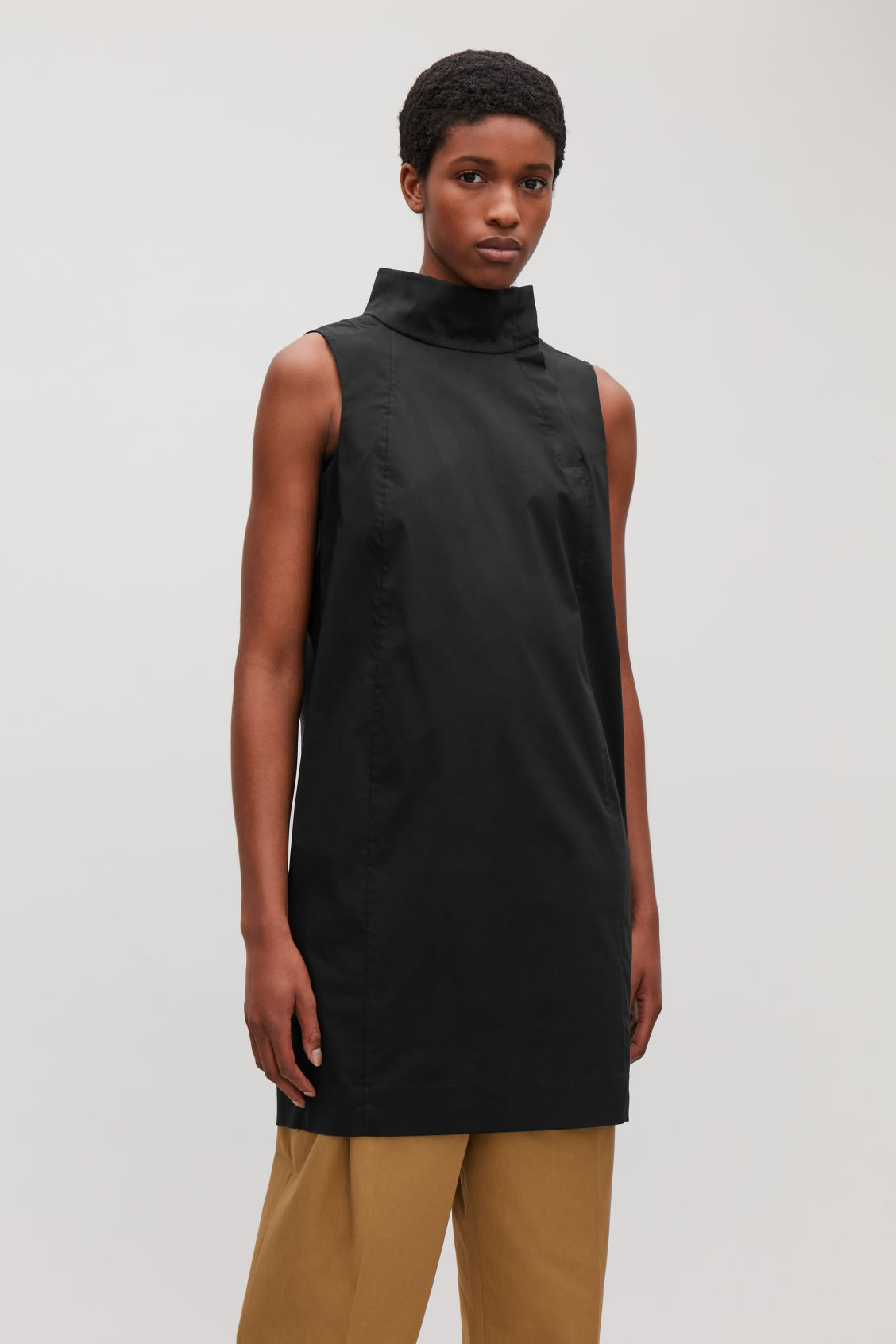 Model Side Image Of Cos Sleeveless Dress With High Neck In Black