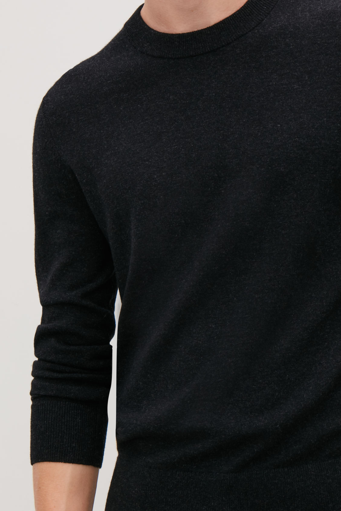 Model side image of Cos wool-yak crew-neck jumper in black