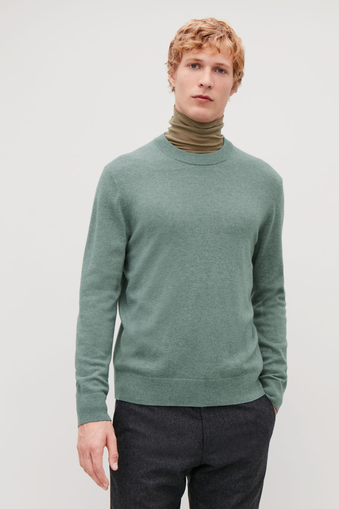 Model side image of Cos wool-yak crew-neck jumper in green