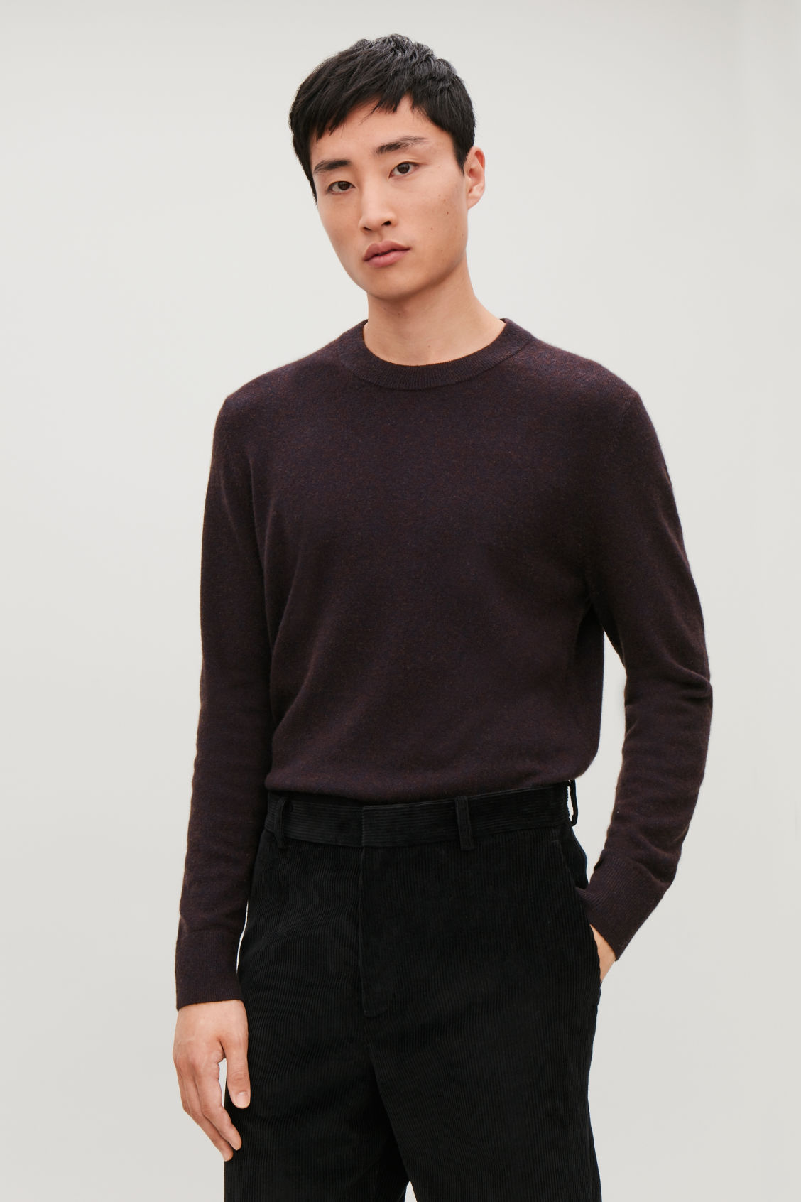 Model side image of Cos wool-yak crew-neck jumper in brown