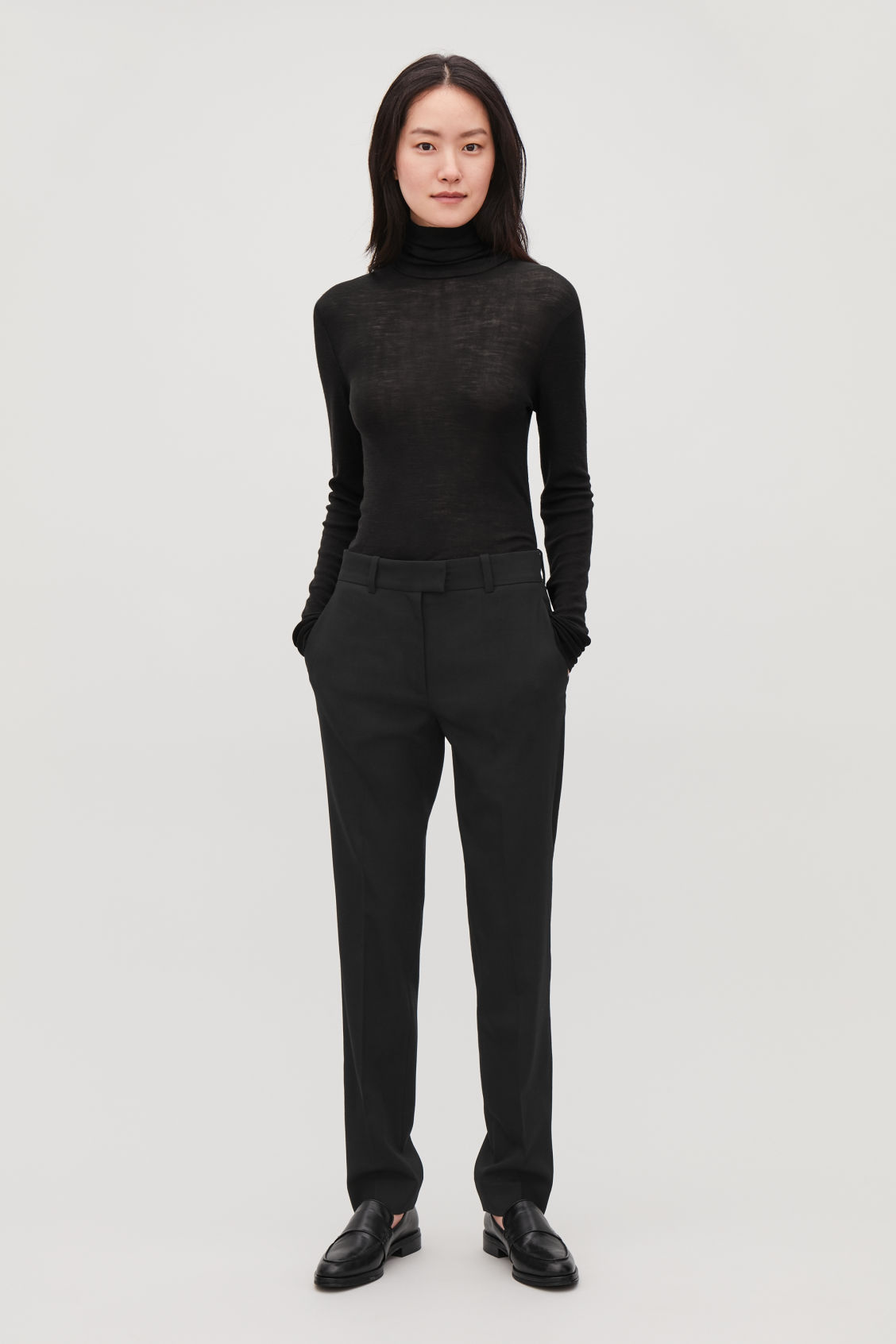 Model front image of Cos tailored wool trousers in black