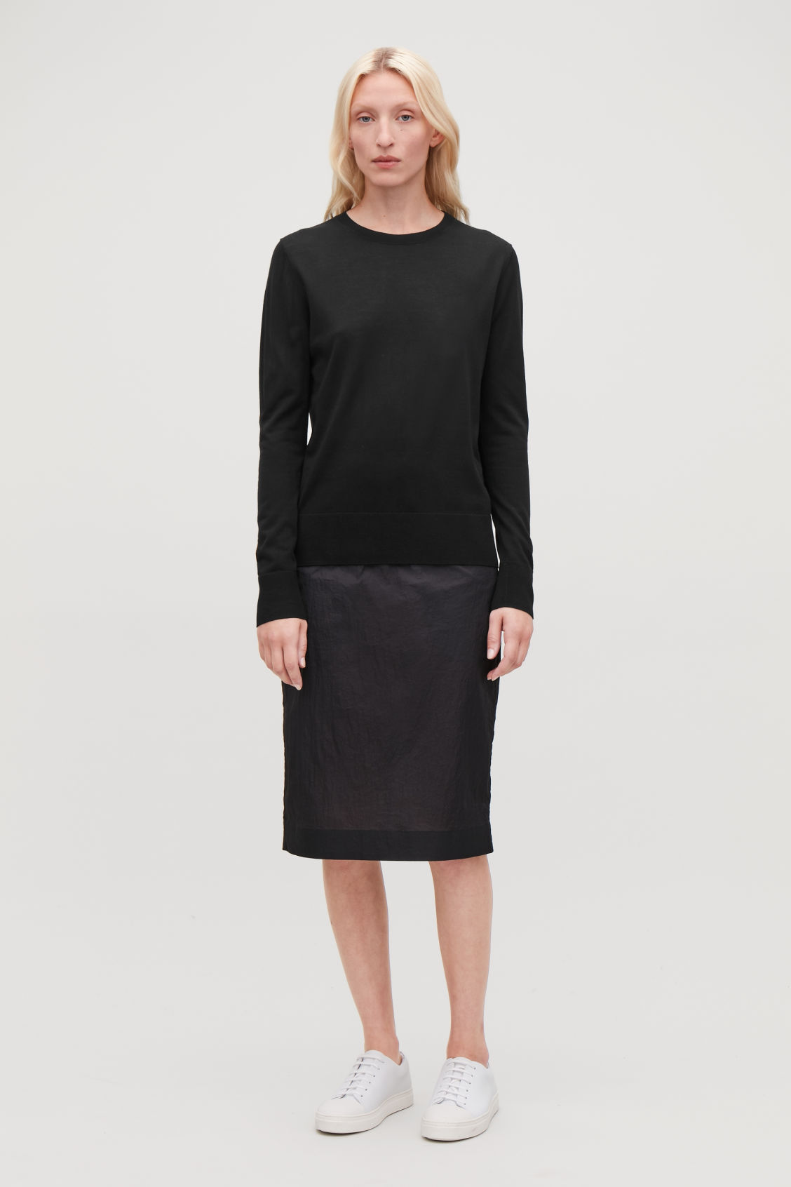 Model front image of Cos round-neck merino jumper in black