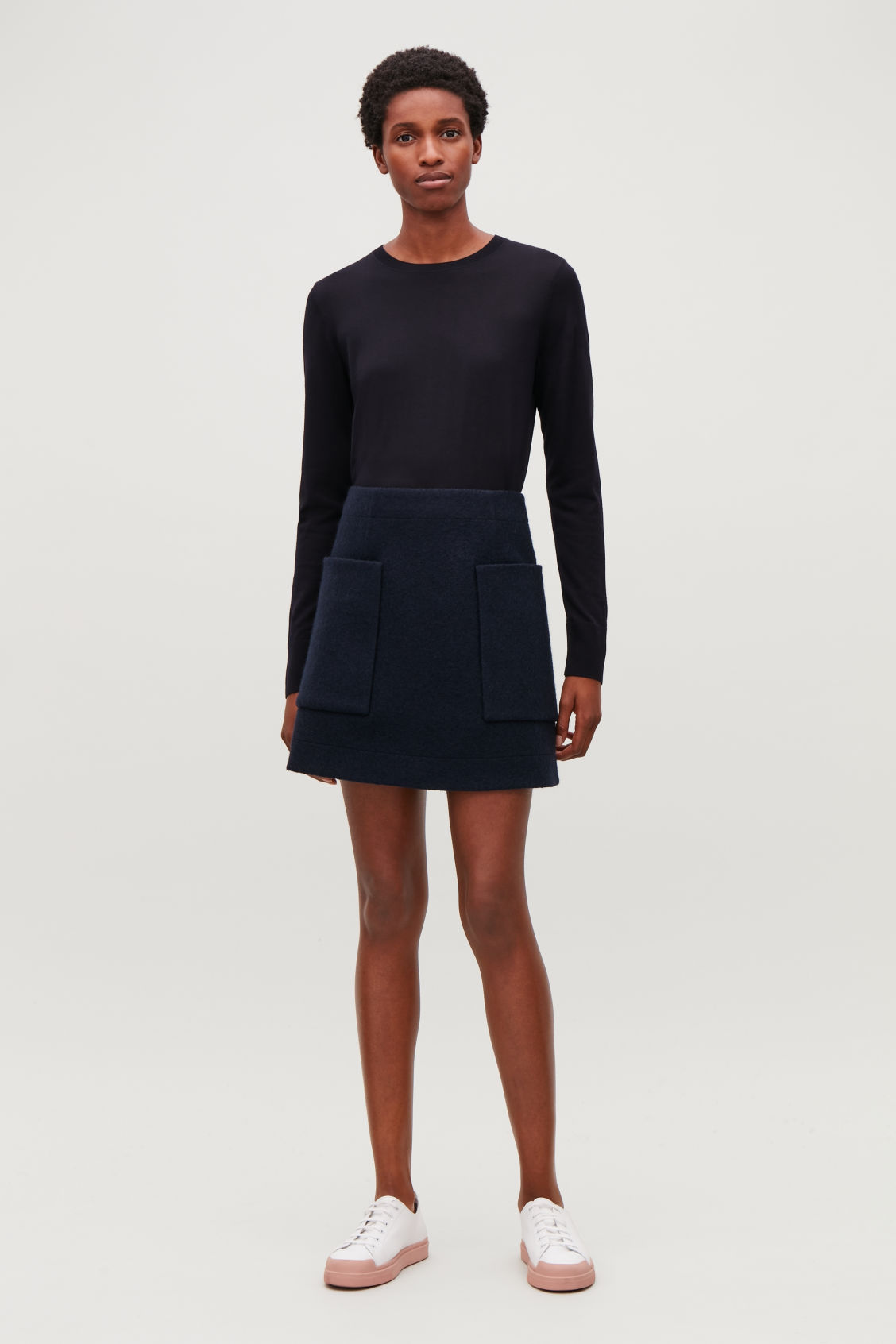 Model side image of Cos round-neck merino jumper in blue